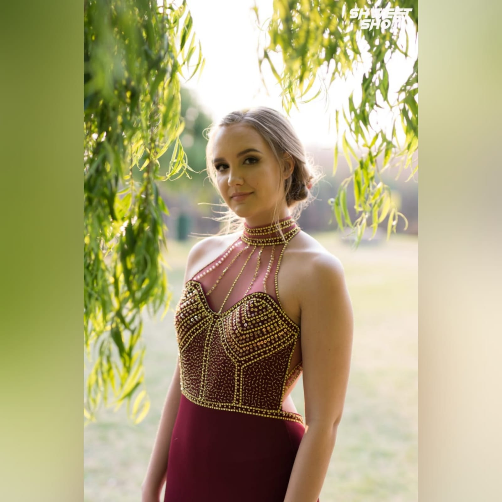 Maroon and gold matric farewell dress with a beaded bodice 9 maroon and gold matric farewell dress with a beaded bodice, low open back with beaded illusion straps. Illusion choker neckline detail with beads and diamante, with a slit and a train.
