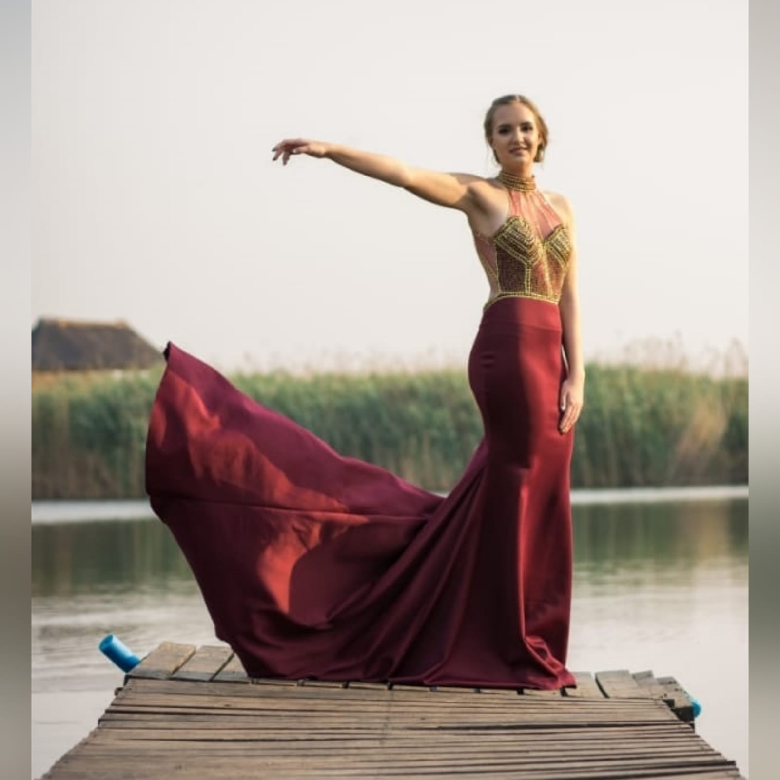 Maroon and gold matric farewell dress with a beaded bodice 1 maroon and gold matric farewell dress with a beaded bodice, low open back with beaded illusion straps. Illusion choker neckline detail with beads and diamante, with a slit and a train.