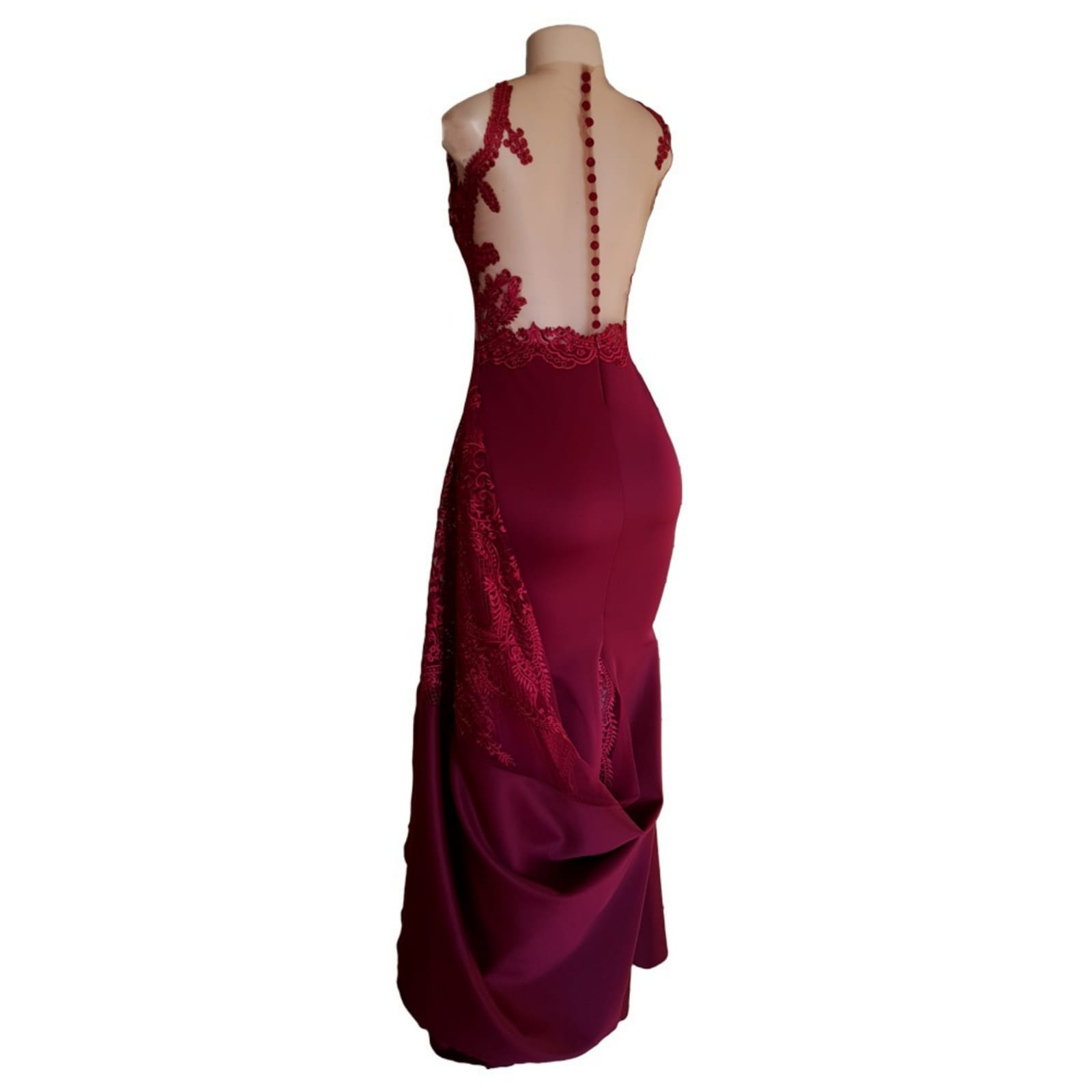 Maroon soft mermaid matric dance dress 6 maroon soft mermaid matric dance dress created to make celine look glorious in her special night. With a sheer lace train that hooks up on the side, a naked illusion back with button and lace detail adding a touch of sensuality and elegance to her look.