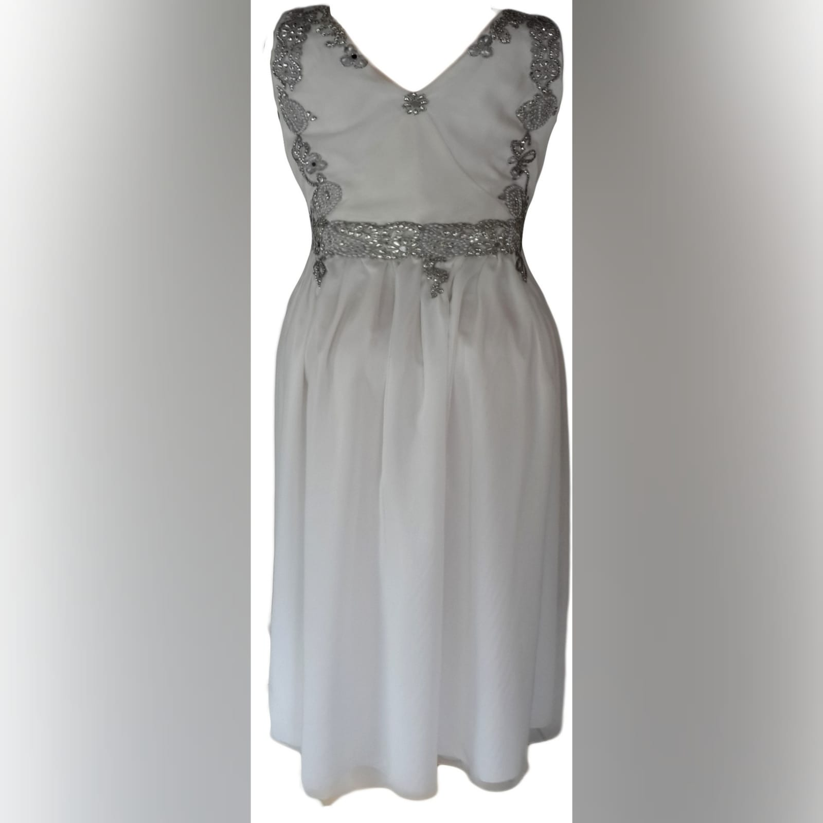 White and silver cross busted flowy wedding dress 3 white and silver cross busted ruched flowy empire fit wedding dress. Front and back detailed with silver bling.