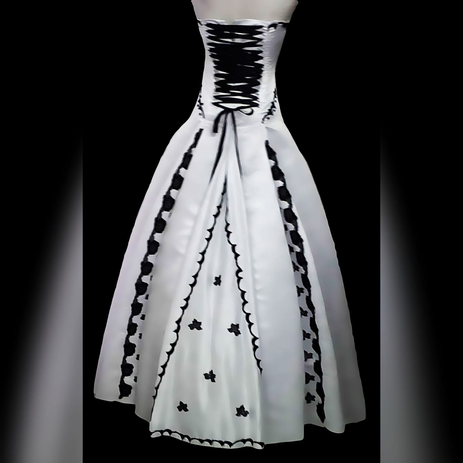 White & black panelled boob tube ballgown wedding dress 2 white panelled boob tube ballgown wedding dress with black lace detail spread throughout the hidden panels of wedding dress and on the under bust area. A lace up back in with black ribbon. When you walk with this dress, it opens to reveal the black lace.
