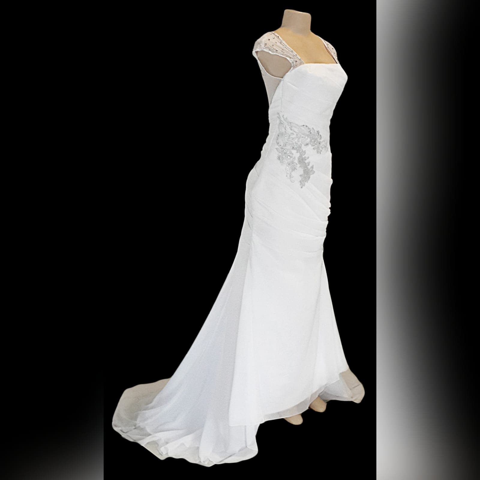 White chiffon pleated wedding dress 7 white chiffon pleated wedding dress with sheer shoulders and back detailed with beads. With white and silver lace detail on the hip and thigh. With a train and covered buttons.