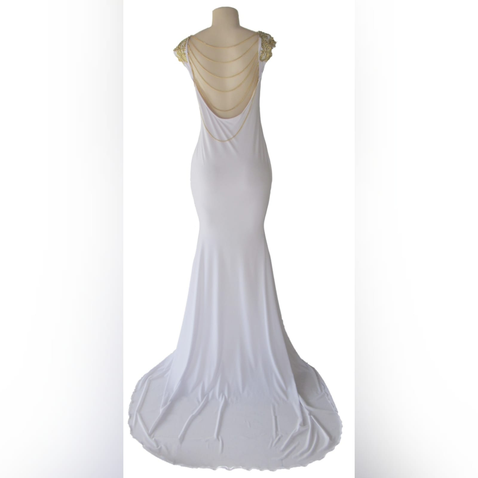 White long jewel neckline matric farewell dress with a rounded open back 3 white long jewel neckline matric farewell dress with a rounded open back, detailed with gold chains, shoulders detailed with gold lace.