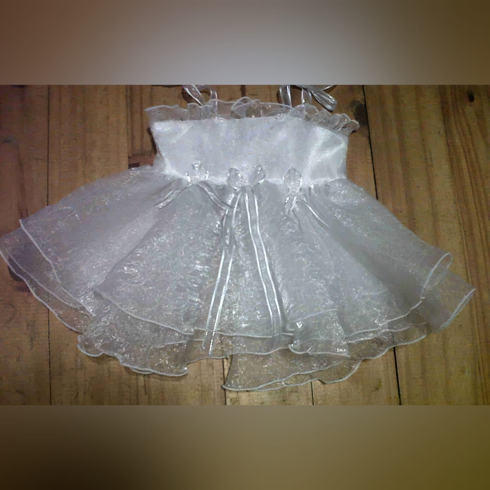 White organza baptism dress with flowers 1 baptism dress made from crushed organza detailed with beaded flowers and silver detailed ribbon.