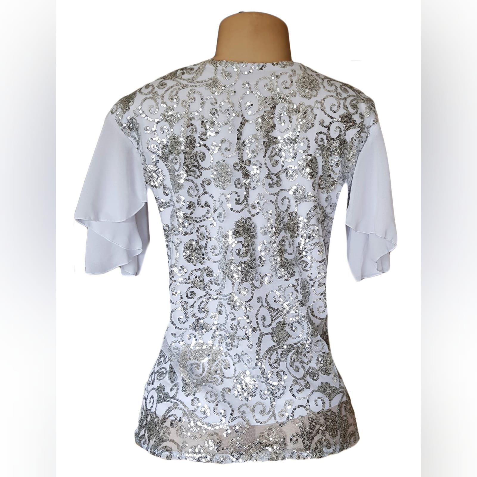 White patterned sequins smart casual top 3 white patterned sequins smart casual top with a v neckline and short chiffon flowy sleeves