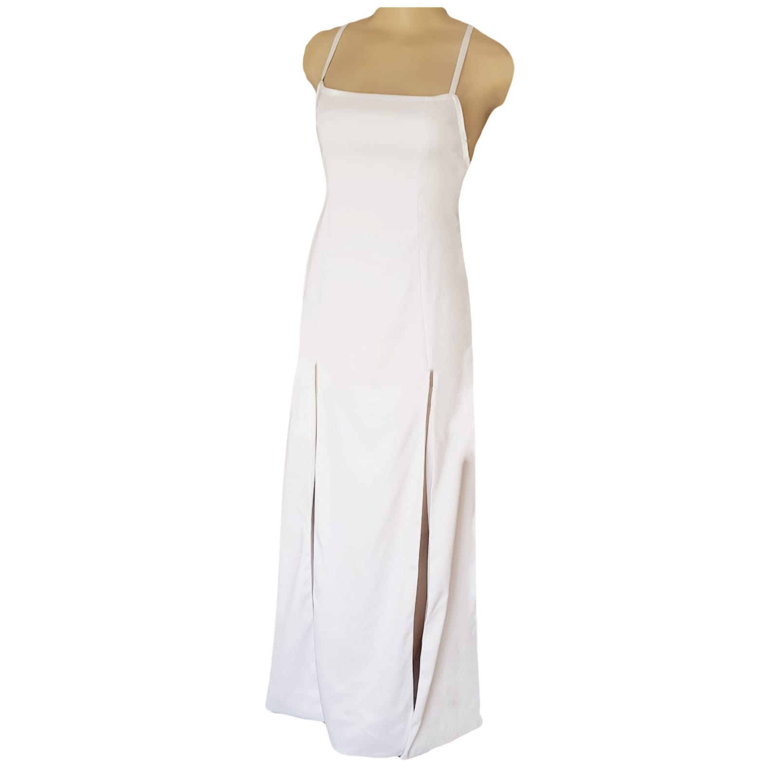 White satin long prom dress with a low open back 7 white satin long prom dress with a low open back, with strap detail. Straight neckline, 2 slits and a train.