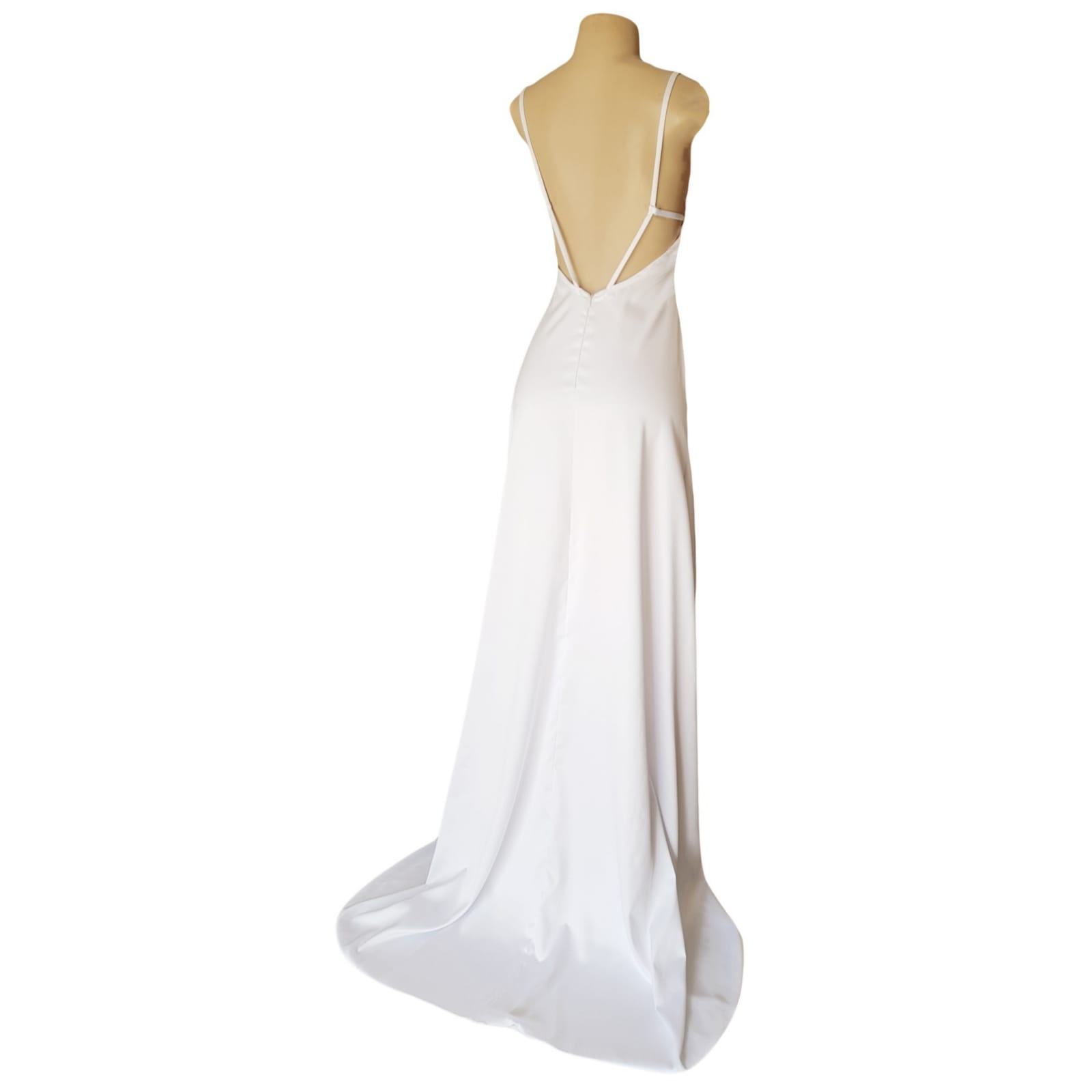 White satin long prom dress with a low open back 6 white satin long prom dress with a low open back, with strap detail. Straight neckline, 2 slits and a train.