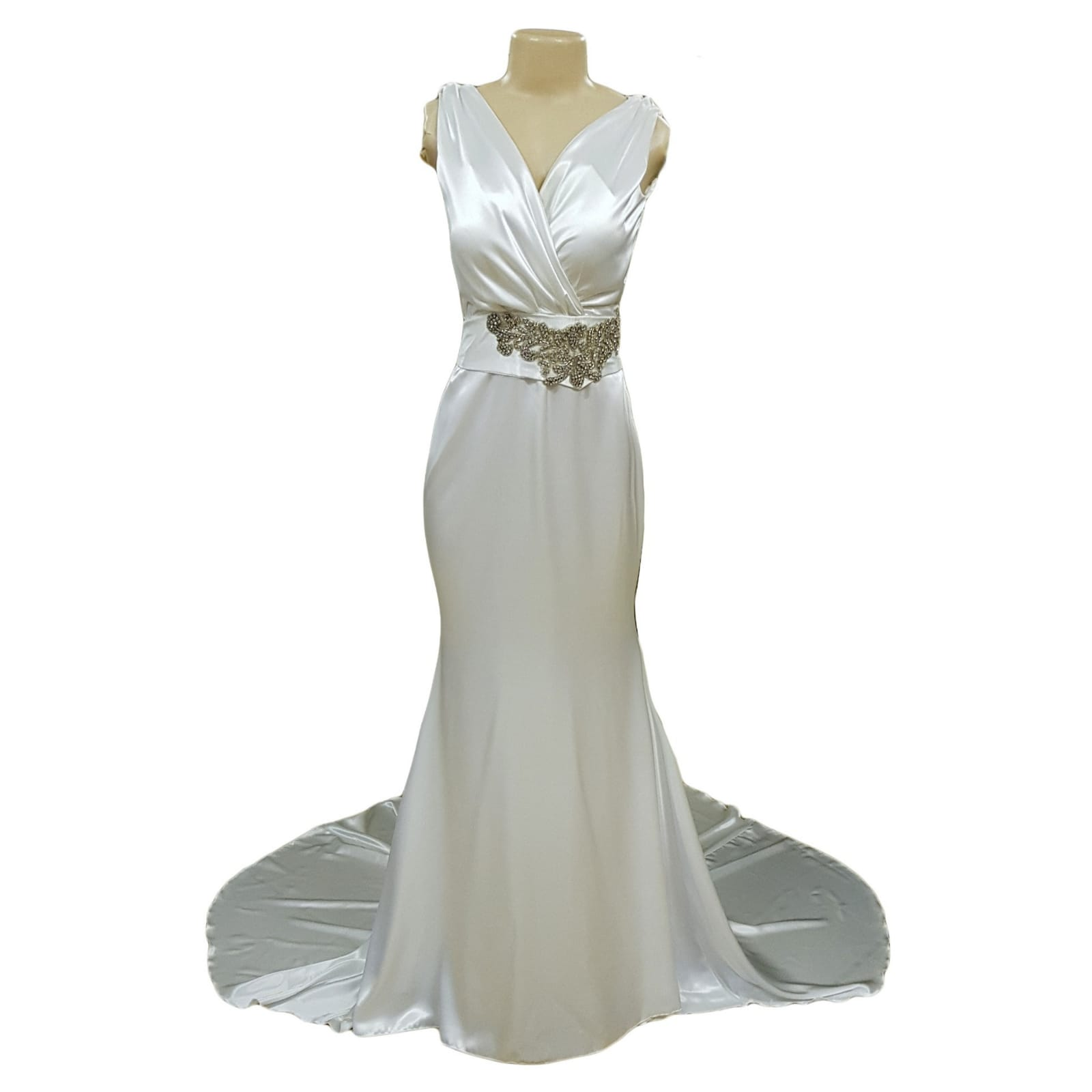 White satin soft mermaid wedding dress with silver belt detail 6 white satin soft mermaid wedding dress, cross busted neckline, open cowl neck back. Angled belt with diamante detail. Train with train hookup.