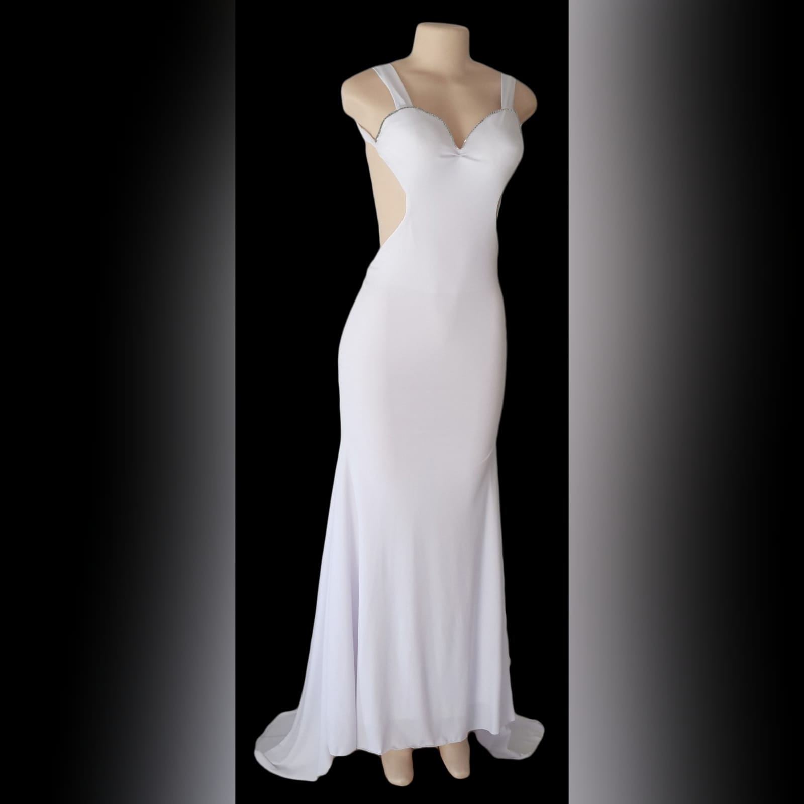White sexy long evening dress with a low open back 1 white sexy long evening dress with a low open back, shoulder straps, sweetheart neckline with a diamante finish and a train