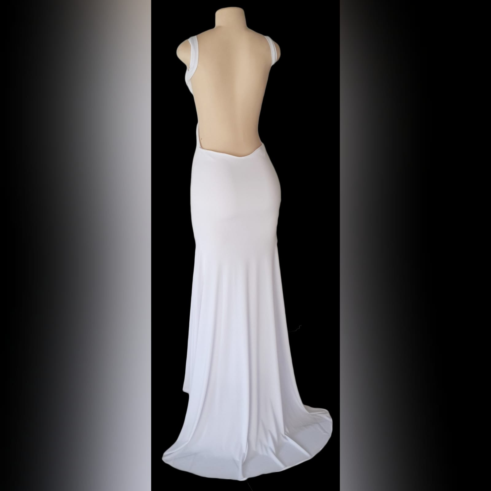 White sexy long evening dress with a low open back 2 white sexy long evening dress with a low open back, shoulder straps, sweetheart neckline with a diamante finish and a train