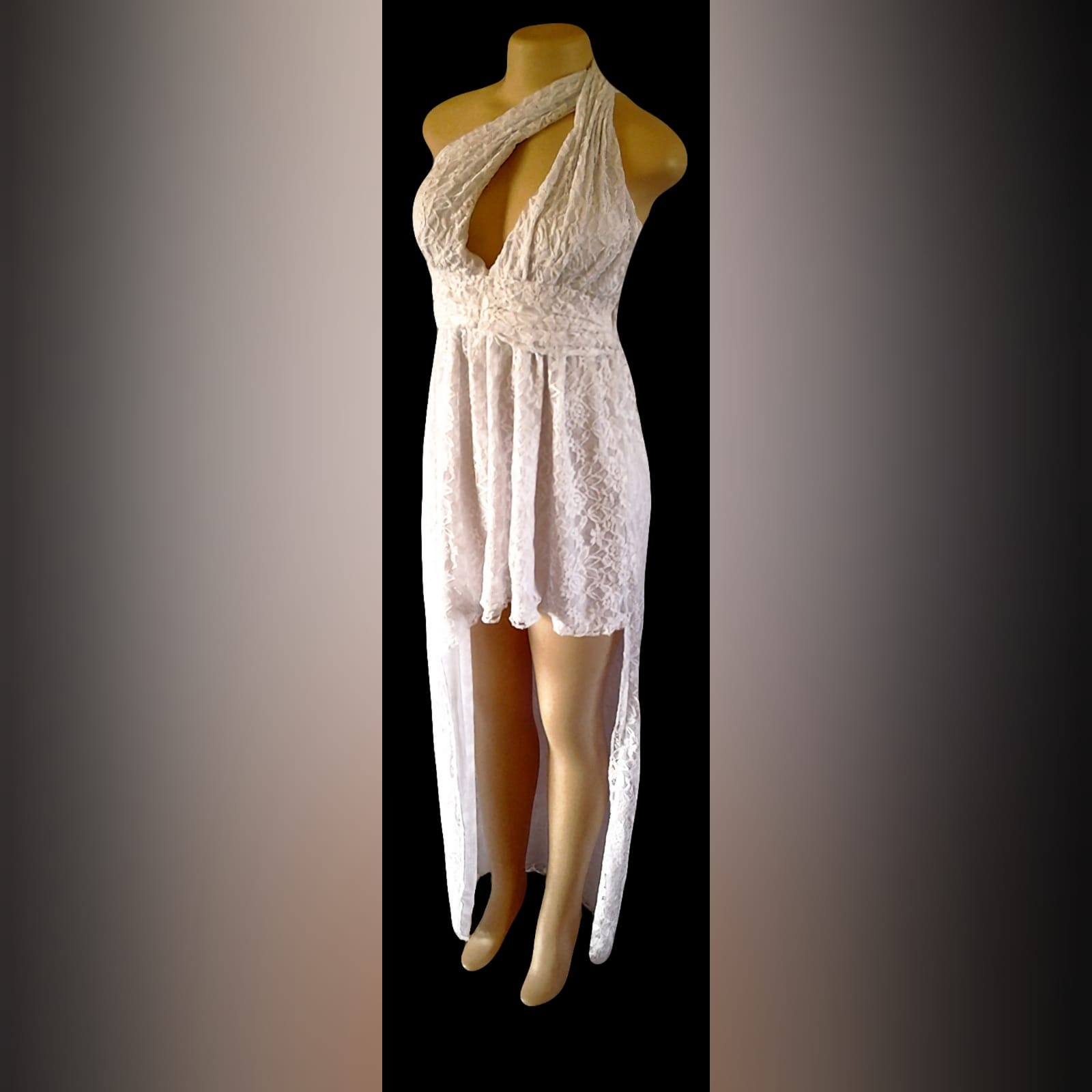 White side high low lace party dress 3 white side high low lace party dress with a cleavage opening and a ruched belt.