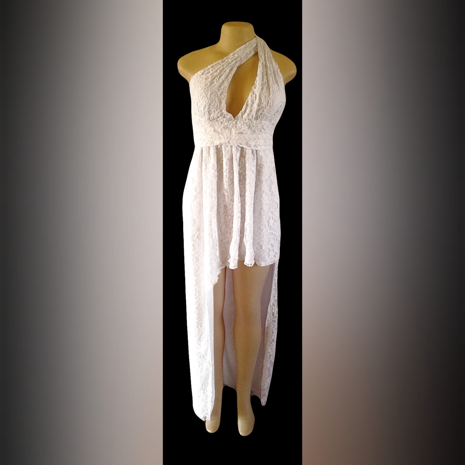 White side high low lace party dress 4 white side high low lace party dress with a cleavage opening and a ruched belt.
