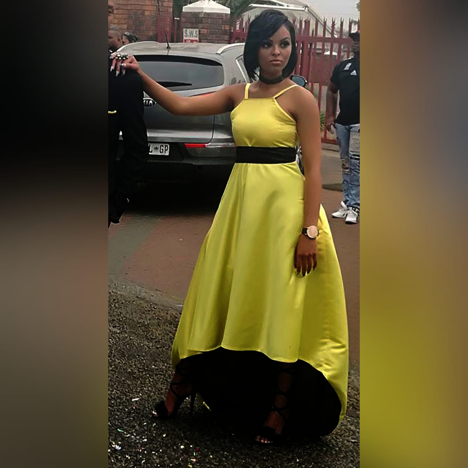 Yellow and black high low prom dress 2 yellow & black high low prom dress with an open back, pockets and a detachable black belt
