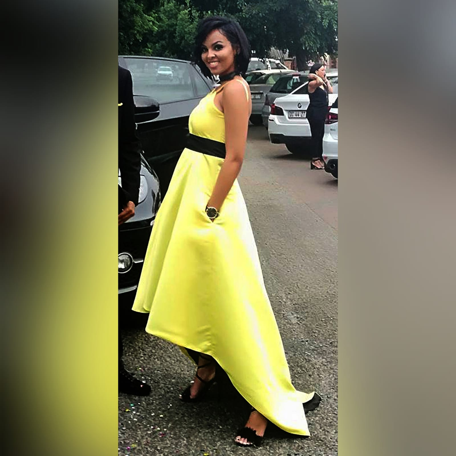 Yellow and black high low prom dress 1 yellow & black high low prom dress with an open back, pockets and a detachable black belt