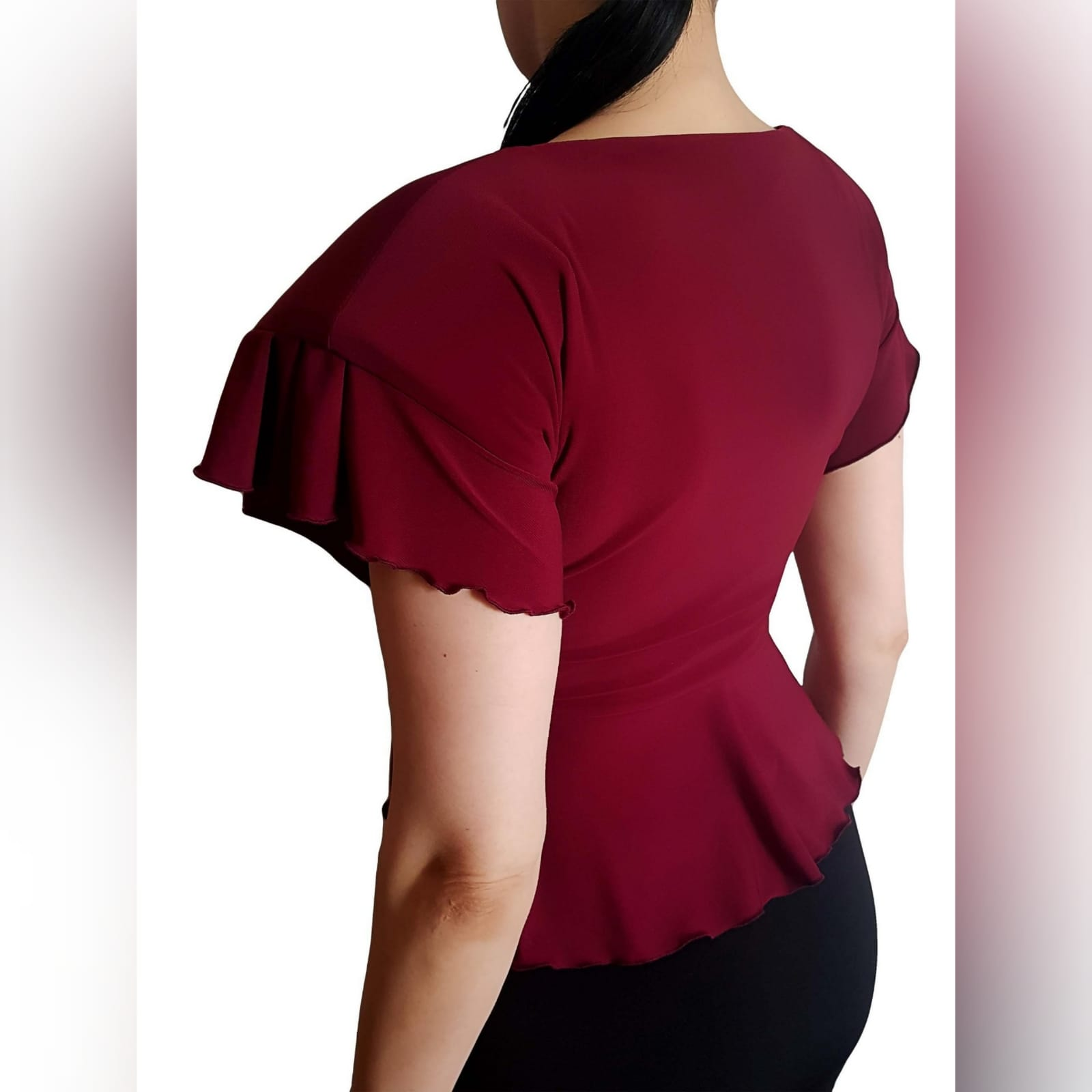 Maroon sexy casual top high waist peplum 3 maroon sexy casual top, with a high waist peplum. Lace-up detail in the front to adjust fit. This elegant top has dramatic shoulders which adds a touch of couture to the look. Handmade top, unique look, and a special piece that you can add to your wardrobe. We offer this high shoulder top in several colours.