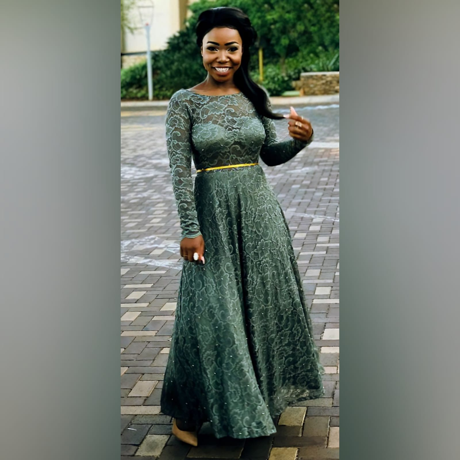 Tea length fully lace olive green evening dress 2 reneilwe looked charming with her tea length fully lace olive green evening dress. Bodice in sheer lace with long sleeves and open back for a feminine touch. With scattered gold beads and a thin removable gold belt to give it a chic look.