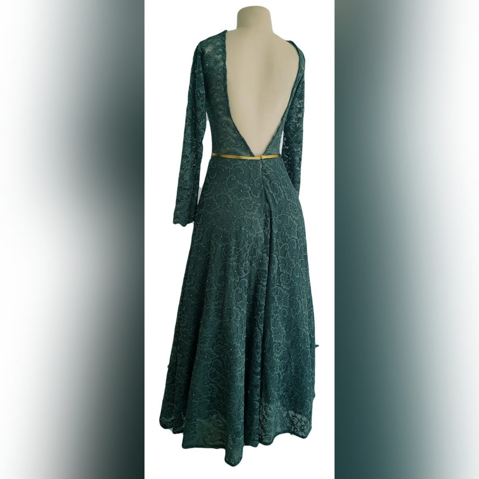 Tea length fully lace olive green evening dress 6 reneilwe looked charming with her tea length fully lace olive green evening dress. Bodice in sheer lace with long sleeves and open back for a feminine touch. With scattered gold beads and a thin removable gold belt to give it a chic look.
