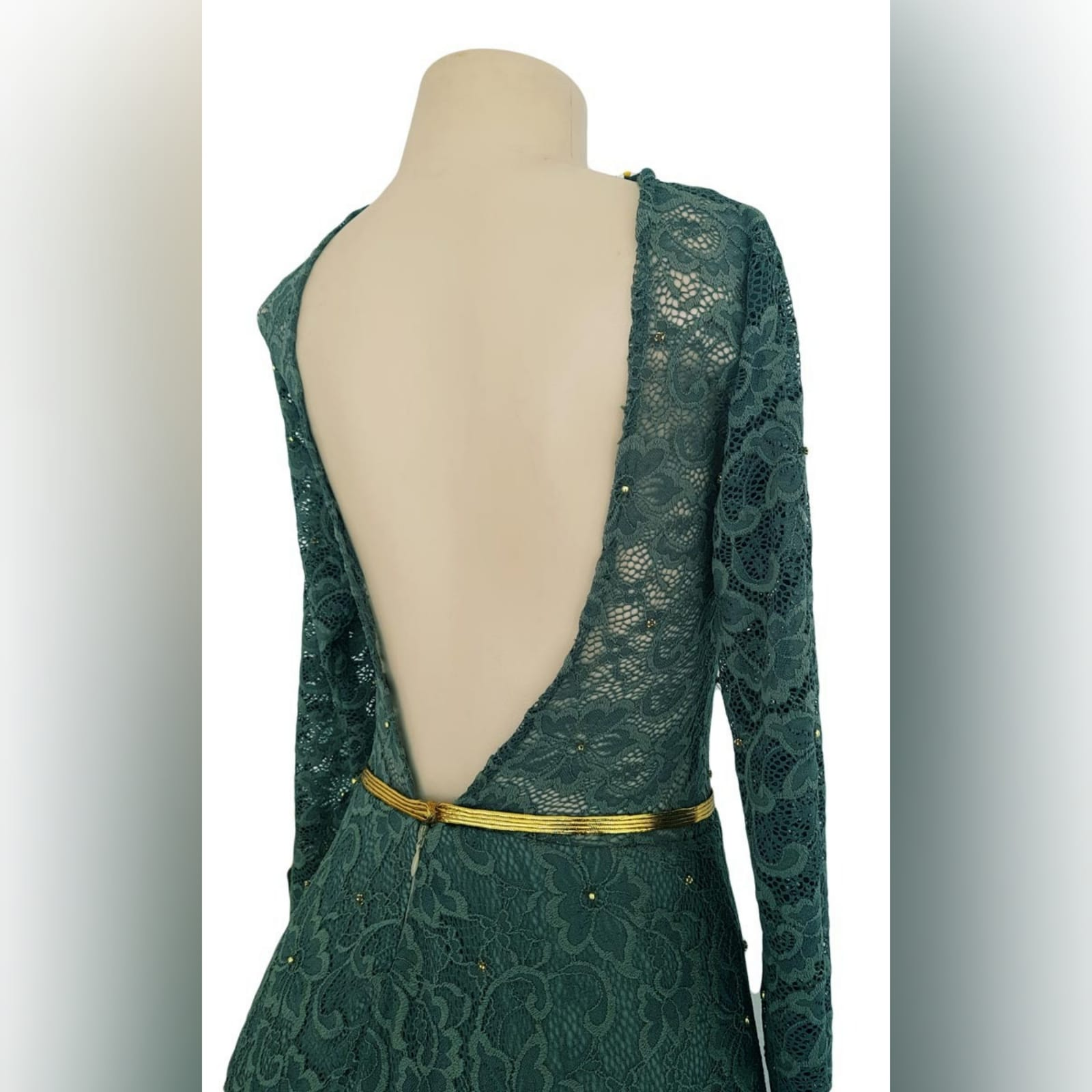 Tea length fully lace olive green evening dress 7 reneilwe looked charming with her tea length fully lace olive green evening dress. Bodice in sheer lace with long sleeves and open back for a feminine touch. With scattered gold beads and a thin removable gold belt to give it a chic look.