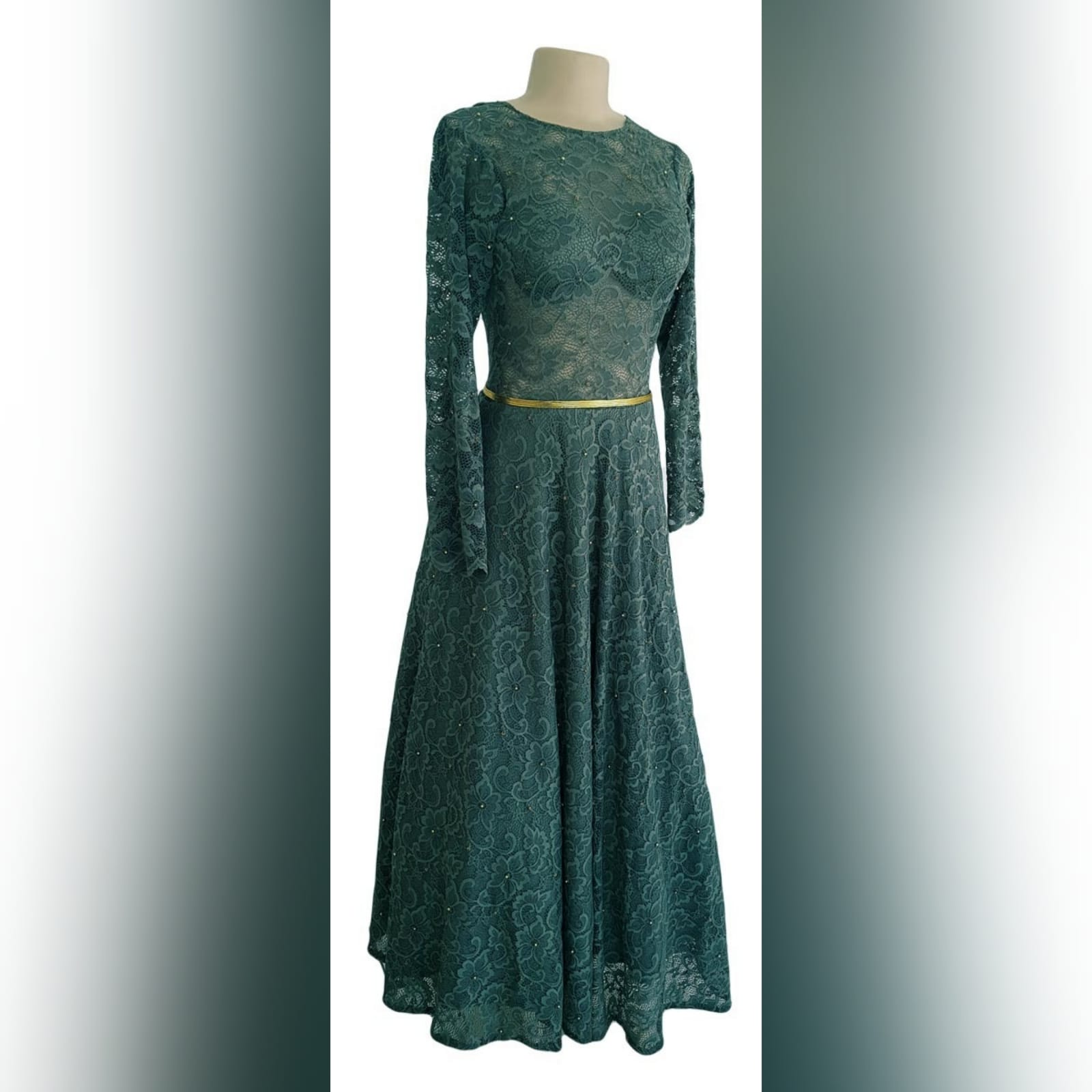 Tea length fully lace olive green evening dress 8 reneilwe looked charming with her tea length fully lace olive green evening dress. Bodice in sheer lace with long sleeves and open back for a feminine touch. With scattered gold beads and a thin removable gold belt to give it a chic look.