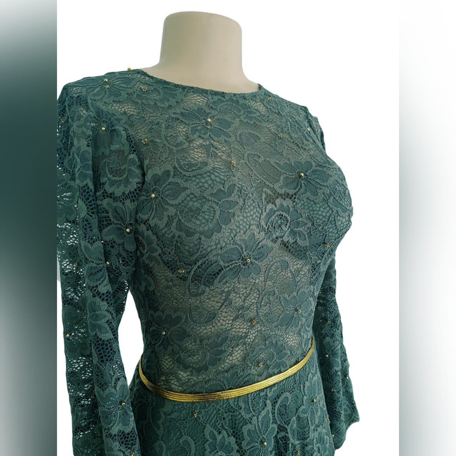 Tea length fully lace olive green evening dress 10 reneilwe looked charming with her tea length fully lace olive green evening dress. Bodice in sheer lace with long sleeves and open back for a feminine touch. With scattered gold beads and a thin removable gold belt to give it a chic look.