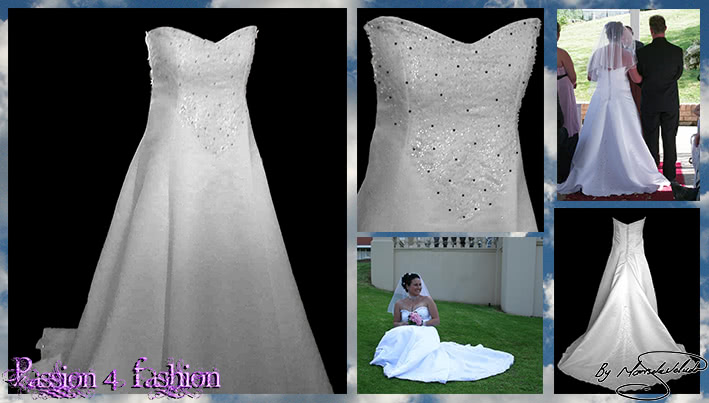 White & silver ball gown wedding dress. Bodice detailed with silver detail and beads. Falling to the ballgown. Back detailed with silver covered buttons.