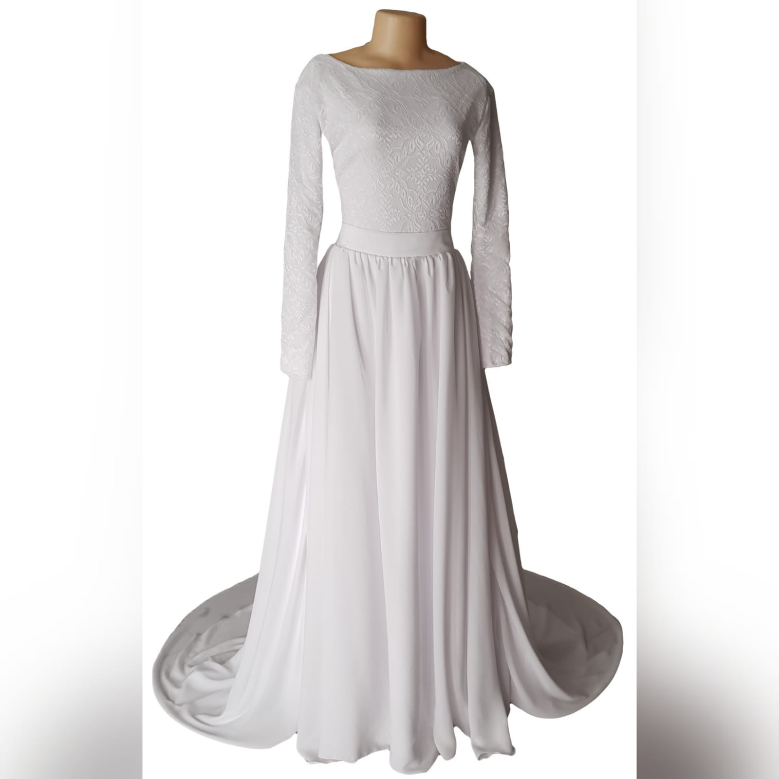 2 piece white flowy simple wedding dress 5 2 piece white flowy simple wedding dress. A bodysuit fitted lace top with long sleeves and jewel neckline. Flowy wide long skirt with a chiffon layer and a long train.