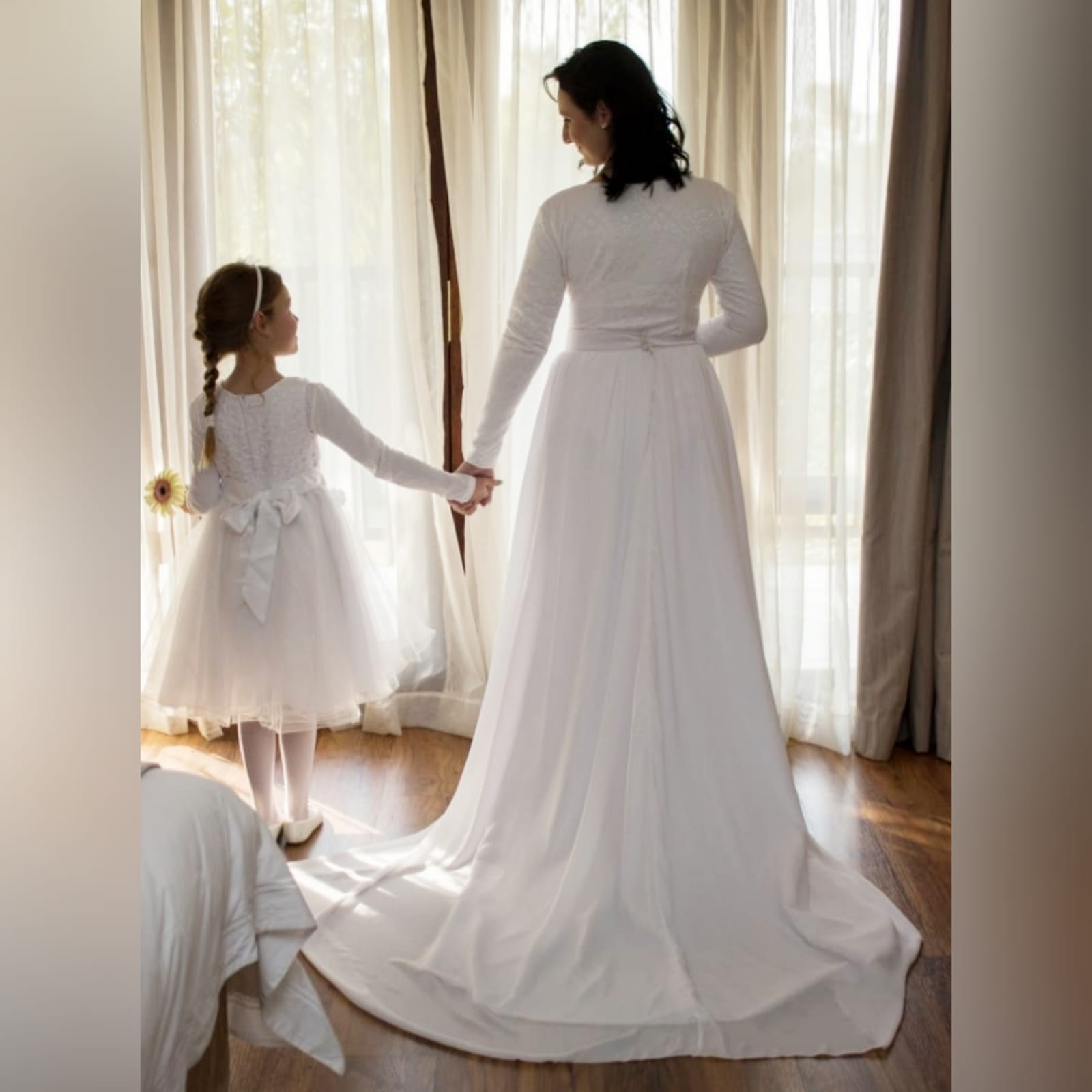2 piece white flowy simple wedding dress 7 2 piece white flowy simple wedding dress. A bodysuit fitted lace top with long sleeves and jewel neckline. Flowy wide long skirt with a chiffon layer and a long train.
