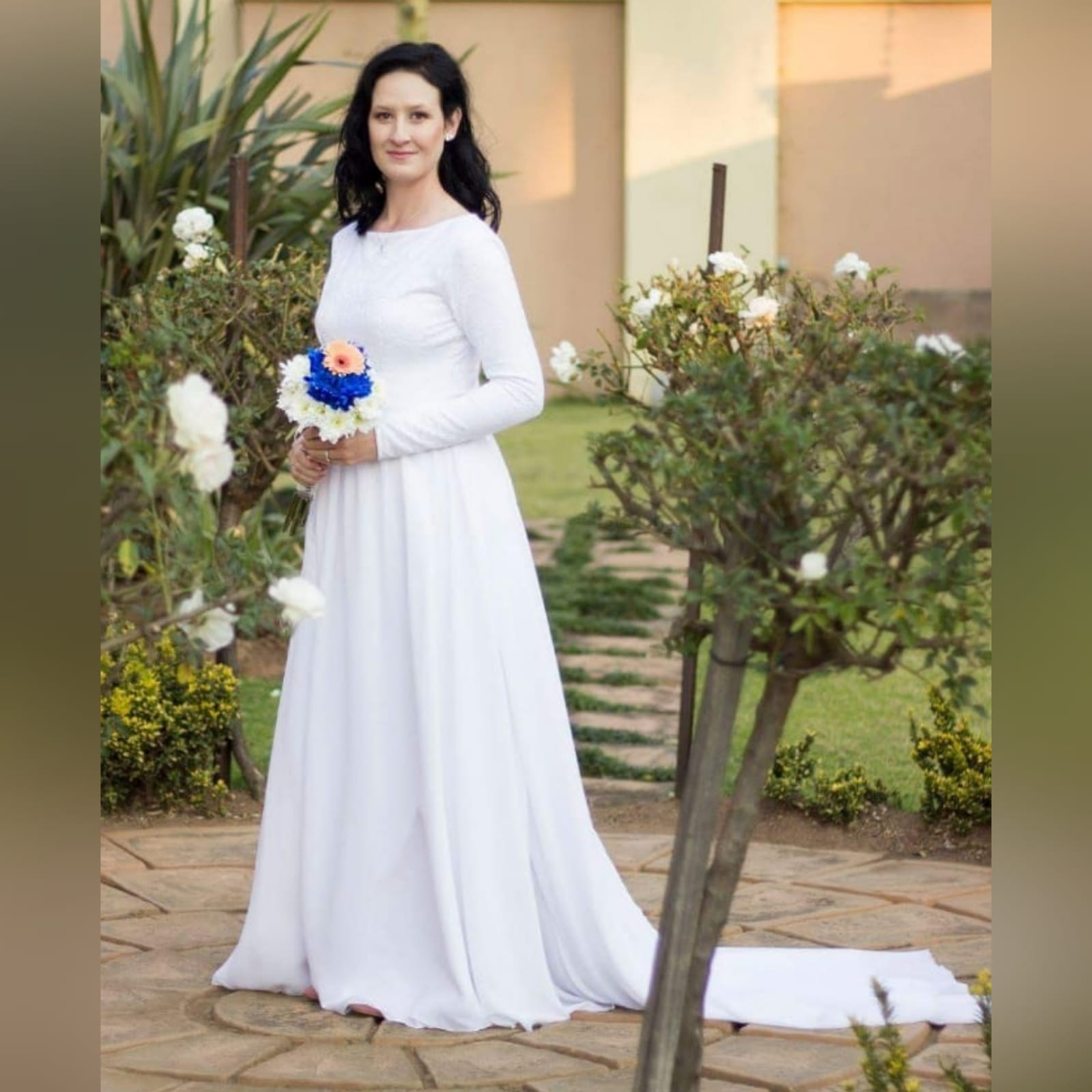 2 piece white flowy simple wedding dress 1 2 piece white flowy simple wedding dress. A bodysuit fitted lace top with long sleeves and jewel neckline. Flowy wide long skirt with a chiffon layer and a long train.