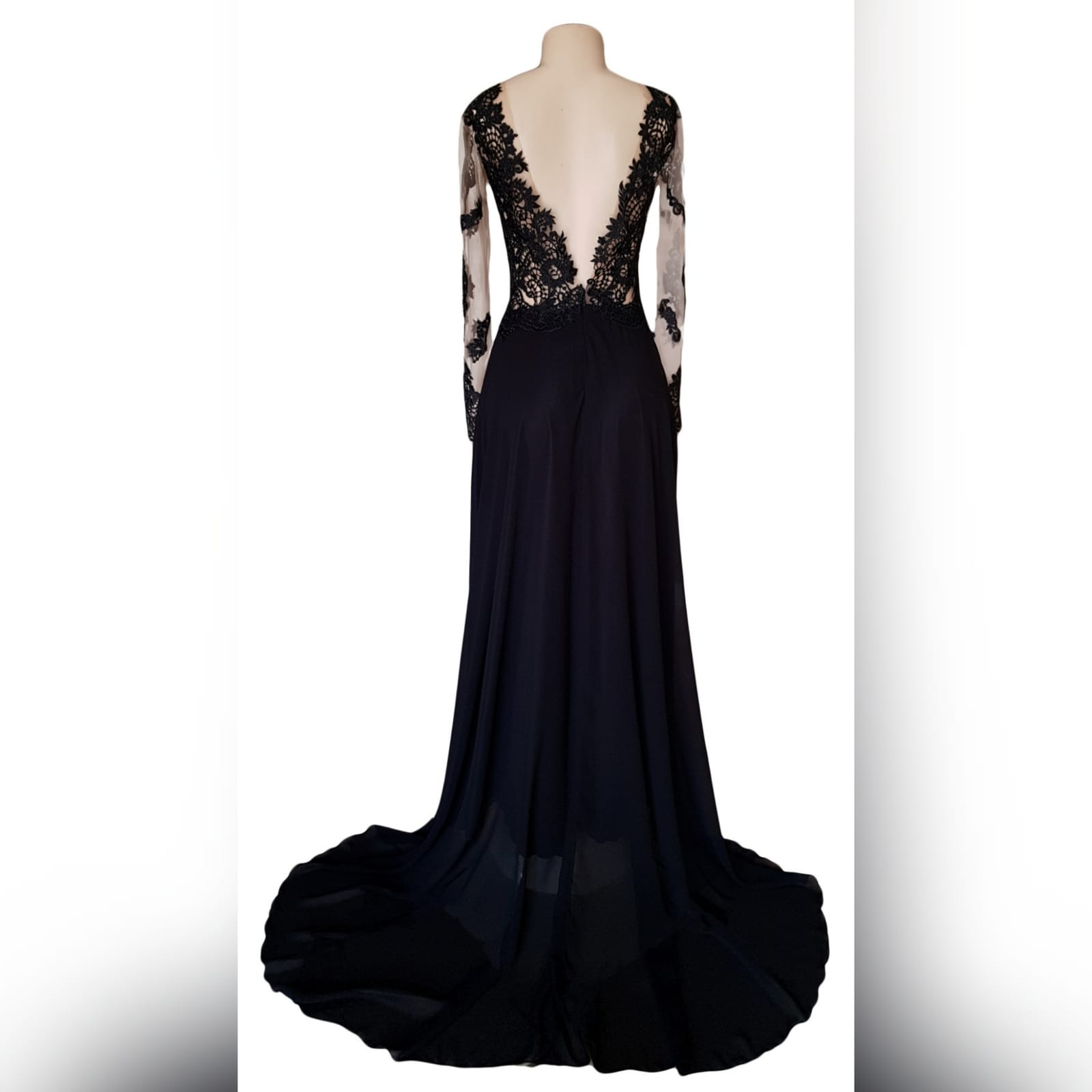 Black lace long flowy prom dress 3 black lace long flowy prom dress with an illusion plunging neckline, long illusion lace sleeves, v open back with a train and a slit.