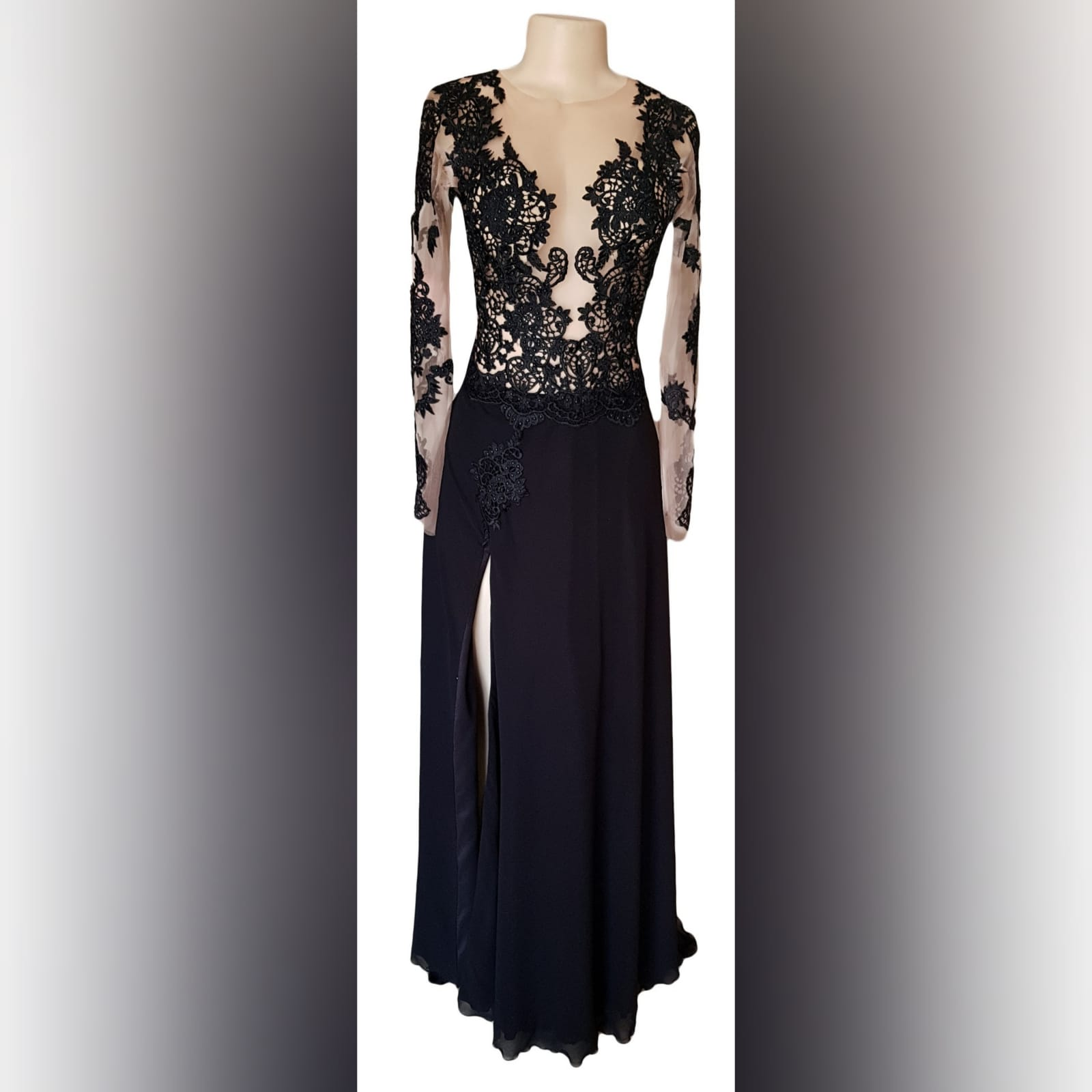 Black lace long flowy prom dress 2 black lace long flowy prom dress with an illusion plunging neckline, long illusion lace sleeves, v open back with a train and a slit.