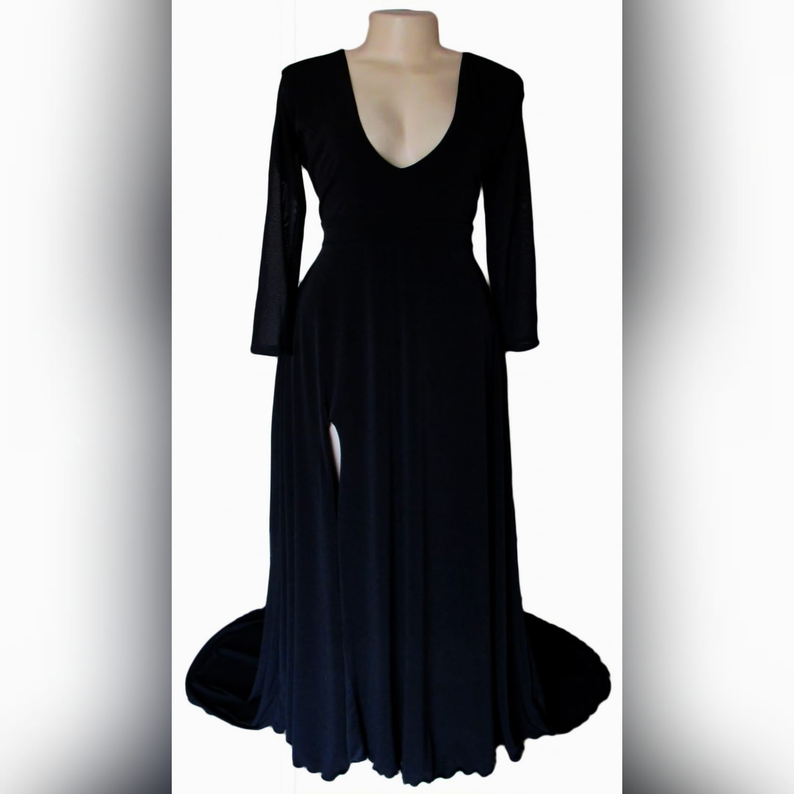 Black simple long formal dress 6 black simple long prom dress with a front and back v neckline. With translucent long sleeves. Slit and a train.