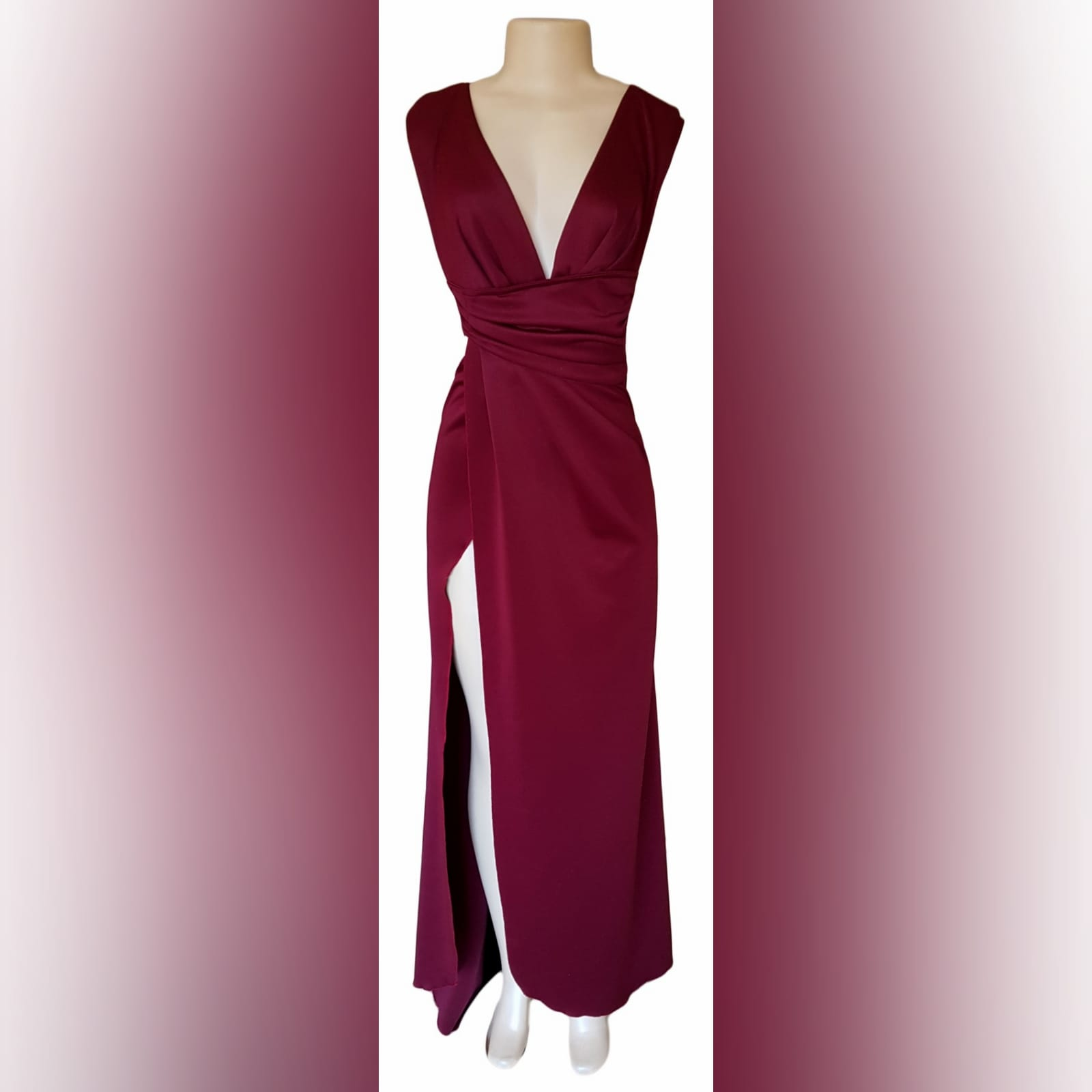 Burgundy draped long prom dress 7 burgundy draped long prom dress with a plunging neckline, sides open, crossed slit and a little train.