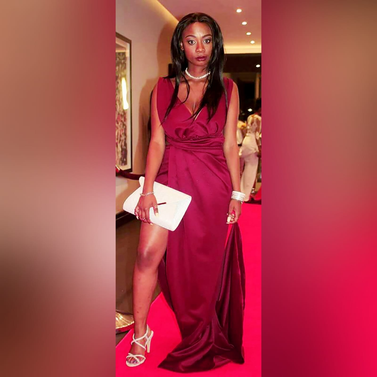 Burgundy draped long prom dress 2 burgundy draped long prom dress with a plunging neckline, sides open, crossed slit and a little train.