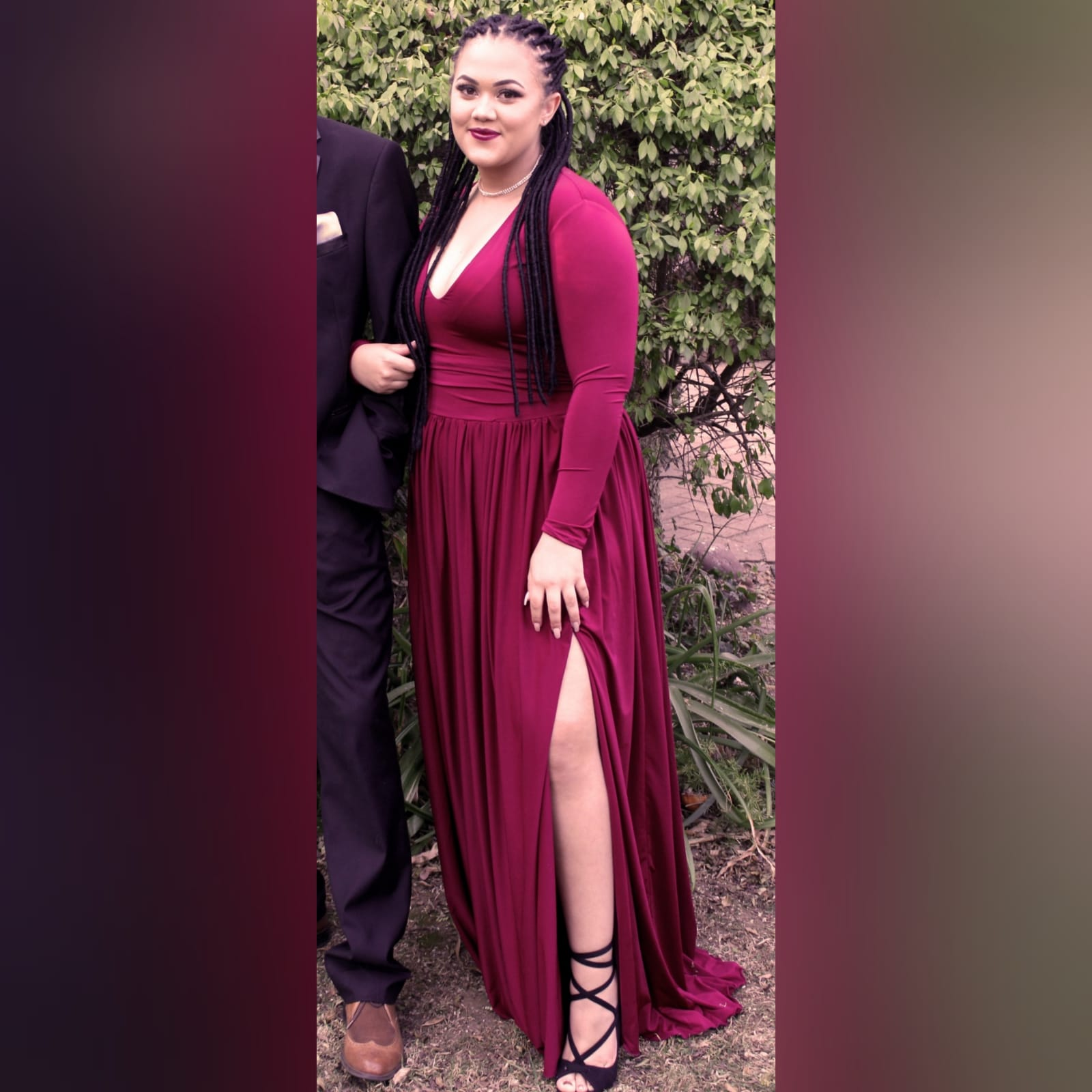 Burgundy simple long prom dress 1 burgundy simple long prom dress with a v neckline, long fitted sleeves, flowy gathered bottom with a slit and a little train.