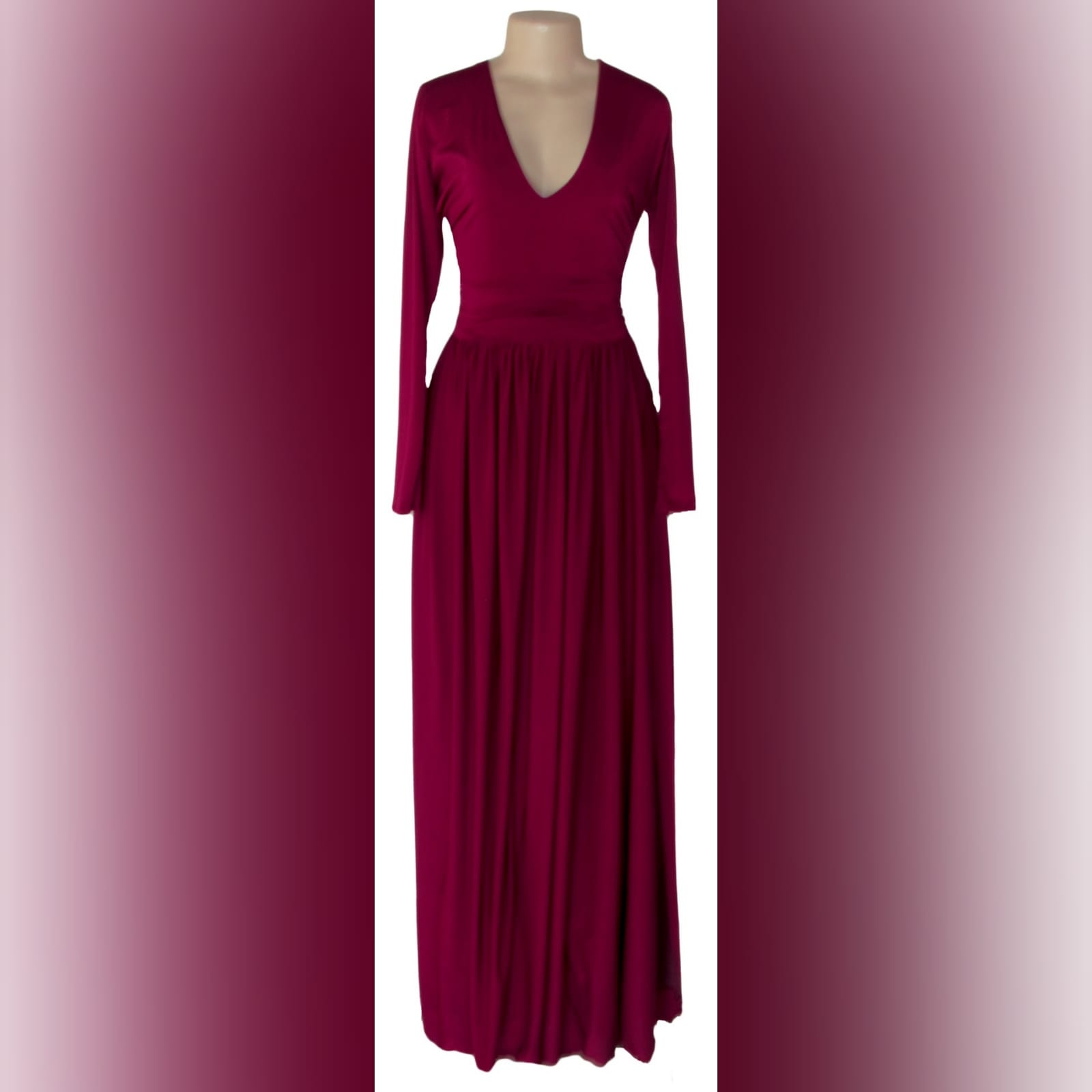 Burgundy simple long prom dress 3 burgundy simple long prom dress with a v neckline, long fitted sleeves, flowy gathered bottom with a slit and a little train.