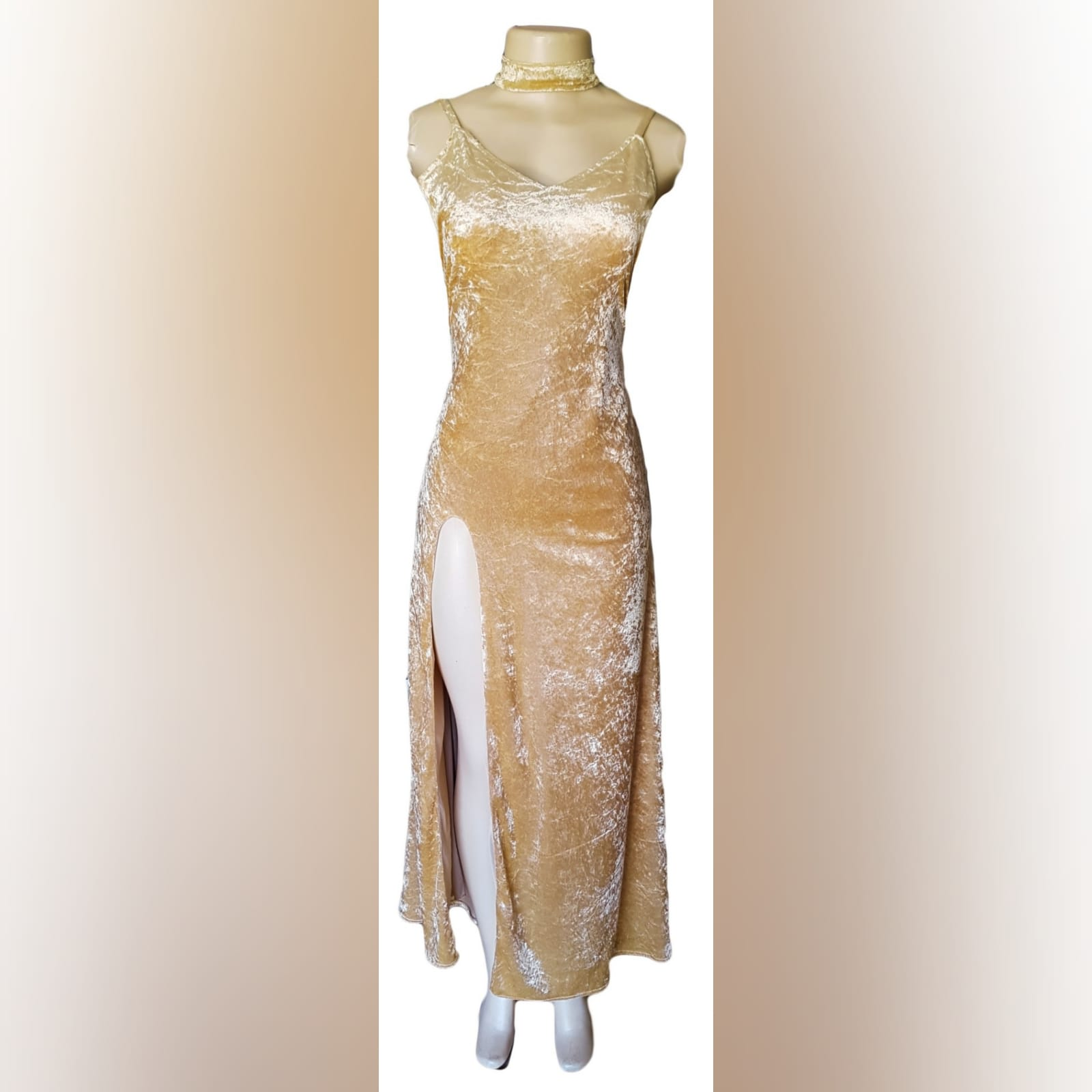 Champagne velvet long prom dress 2 champagne velvet long prom dress with a v neckline, rounded backless design with a high slit and a matching choker.