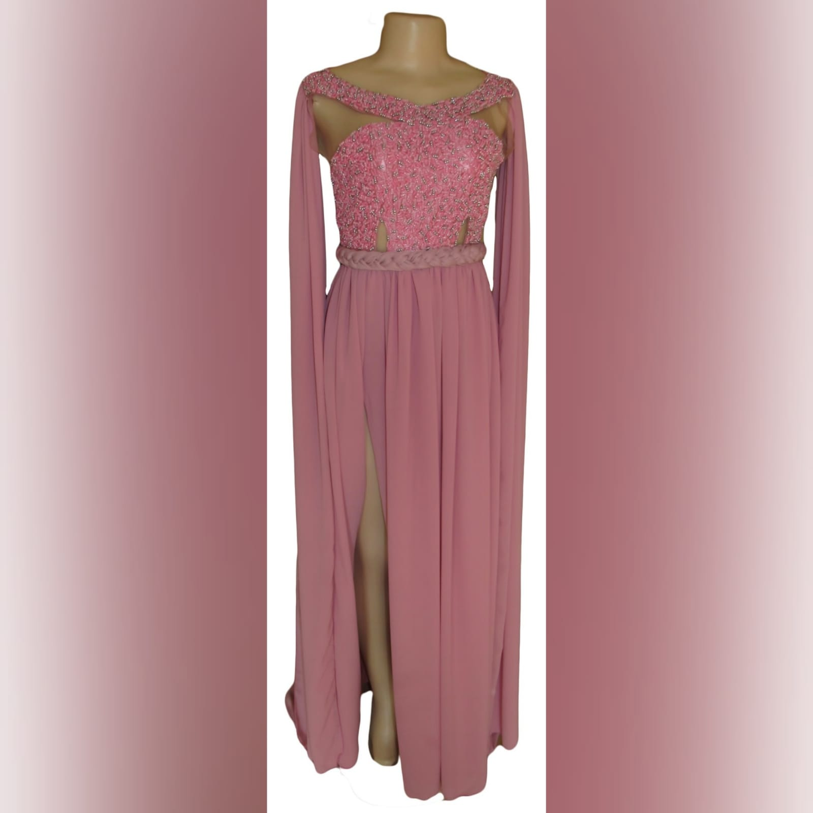 Dusty pink chiffon beaded prom dress 3 dusty pink chiffon beaded prom dress, bateau neckline effect with an illusion back, fully beaded bodice, plaited belt detail with a slit and a train. Shoulders with chiffon draping creating a goddess look.