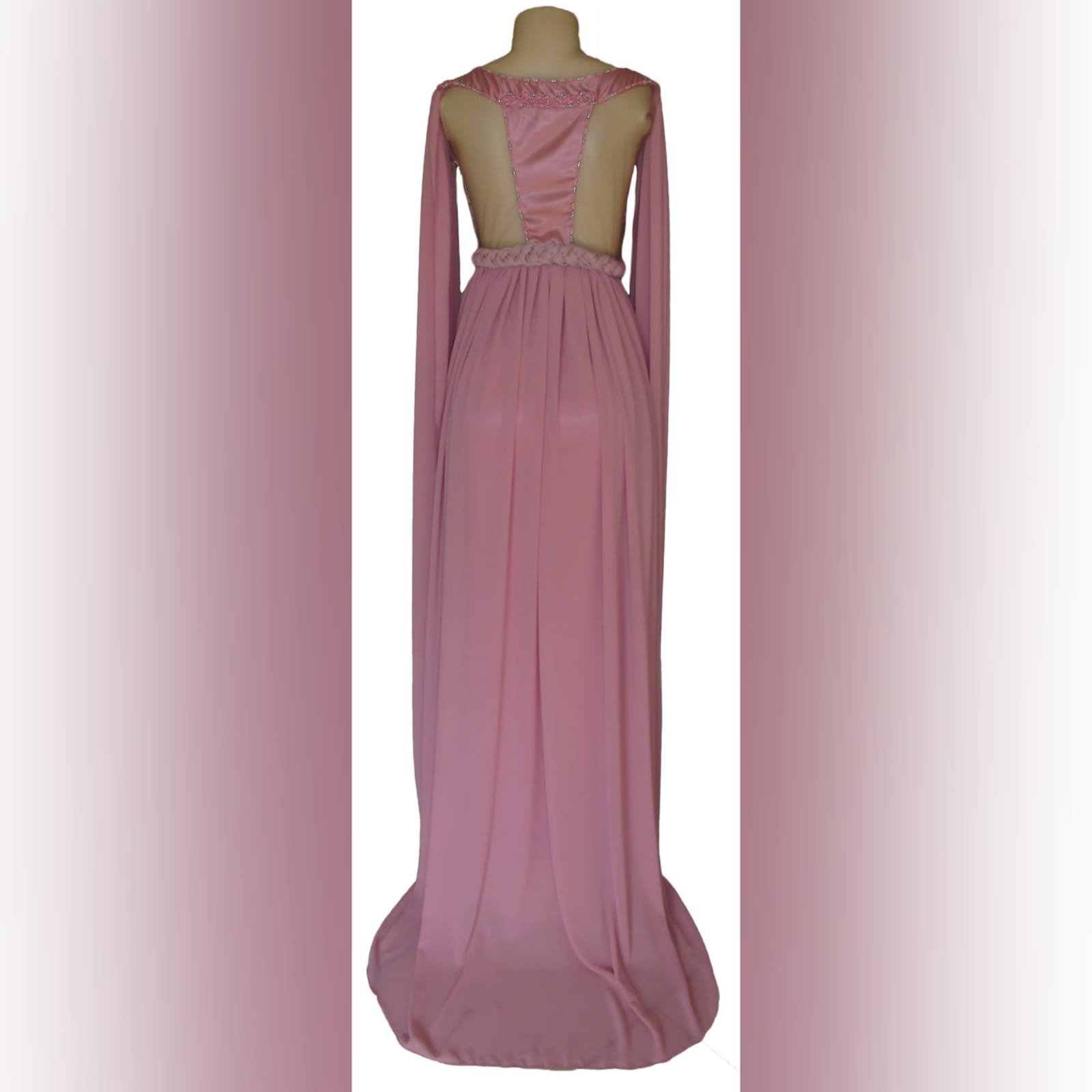 Dusty pink chiffon beaded prom dress 5 dusty pink chiffon beaded prom dress, bateau neckline effect with an illusion back, fully beaded bodice, plaited belt detail with a slit and a train. Shoulders with chiffon draping creating a goddess look.