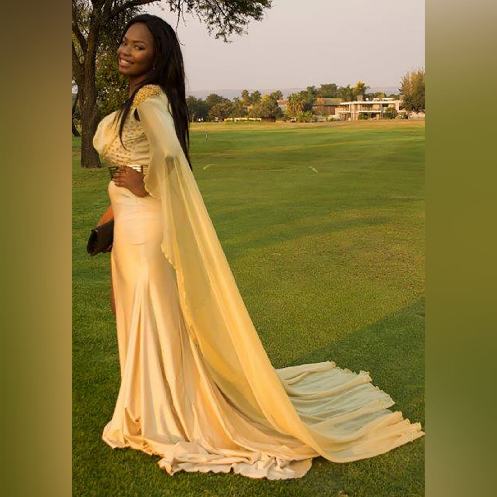 Gold long goddess inspired prom dress 4 gold long goddess inspired prom dress. Long fitted dress with a high slit and a train. With bust detailed with gold beads and a chiffon cowl neck, with a dramatic chiffon cape beaded on the shoulders. With a long train.