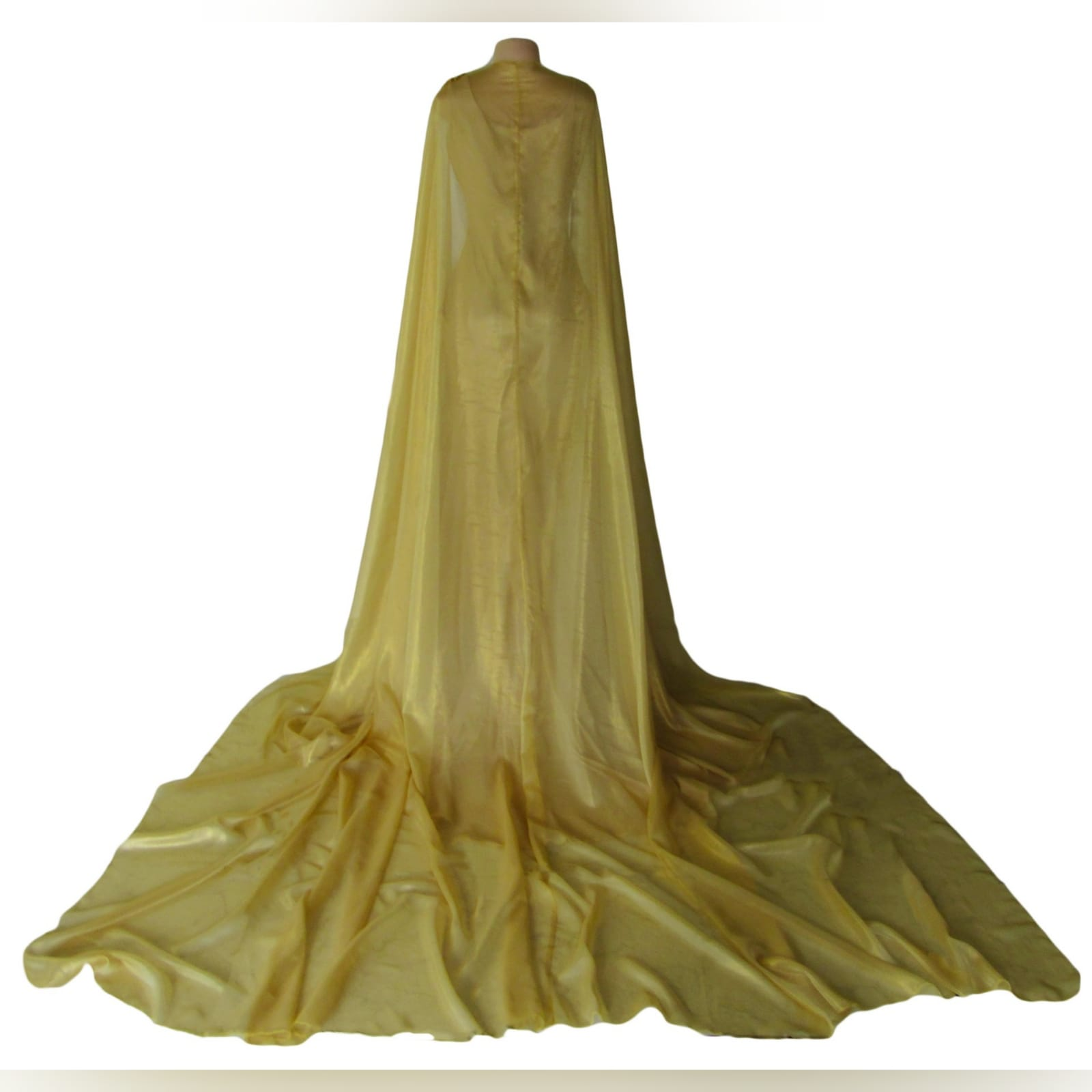 Gold long goddess inspired prom dress 6 gold long goddess inspired prom dress. Long fitted dress with a high slit and a train. With bust detailed with gold beads and a chiffon cowl neck, with a dramatic chiffon cape beaded on the shoulders. With a long train.