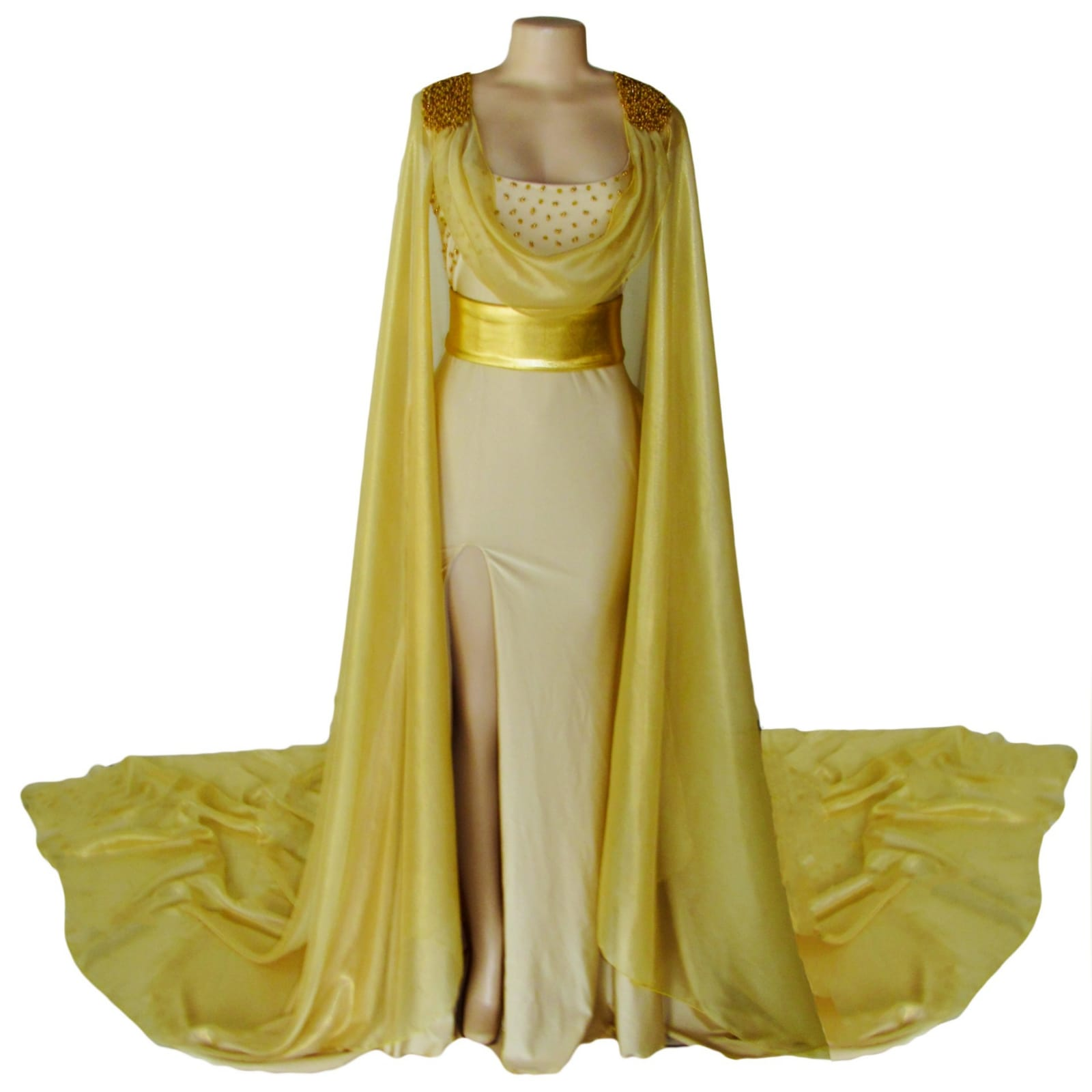 Gold long goddess inspired prom dress 7 gold long goddess inspired prom dress. Long fitted dress with a high slit and a train. With bust detailed with gold beads and a chiffon cowl neck, with a dramatic chiffon cape beaded on the shoulders. With a long train.