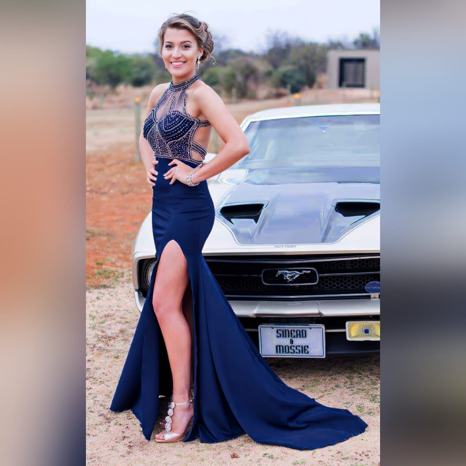 Navy blue silver beaded prom dress 1 navy blue silver beaded prom dress with an illusion neckline and a choker effect. Backless design detailed with beaded straps. Fitted bottom with a slit and a train.