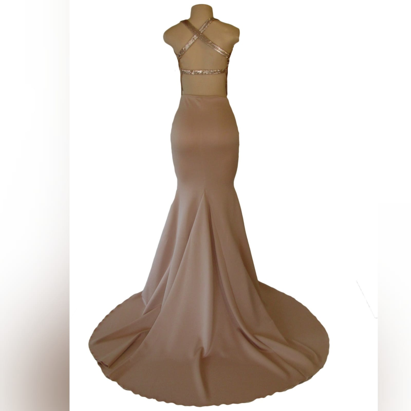 Nude and gold soft mermaid prom dress 6 nude and gold soft mermaid prom dress. Bodice in sequins with a plunging neckline and a naked back detailed with straps. Bottom with a long wide train.