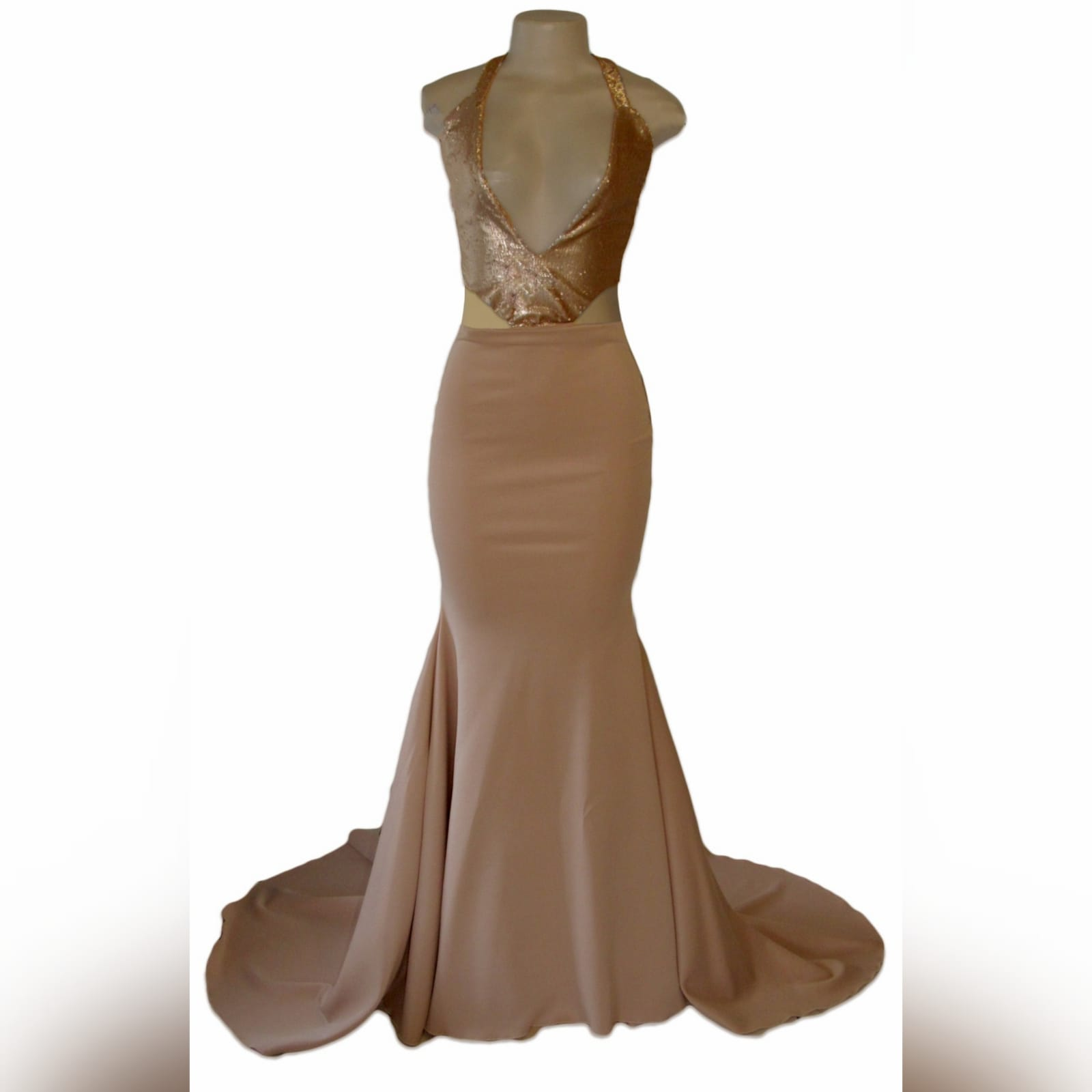 Nude and gold soft mermaid prom dress 4 nude and gold soft mermaid prom dress. Bodice in sequins with a plunging neckline and a naked back detailed with straps. Bottom with a long wide train.