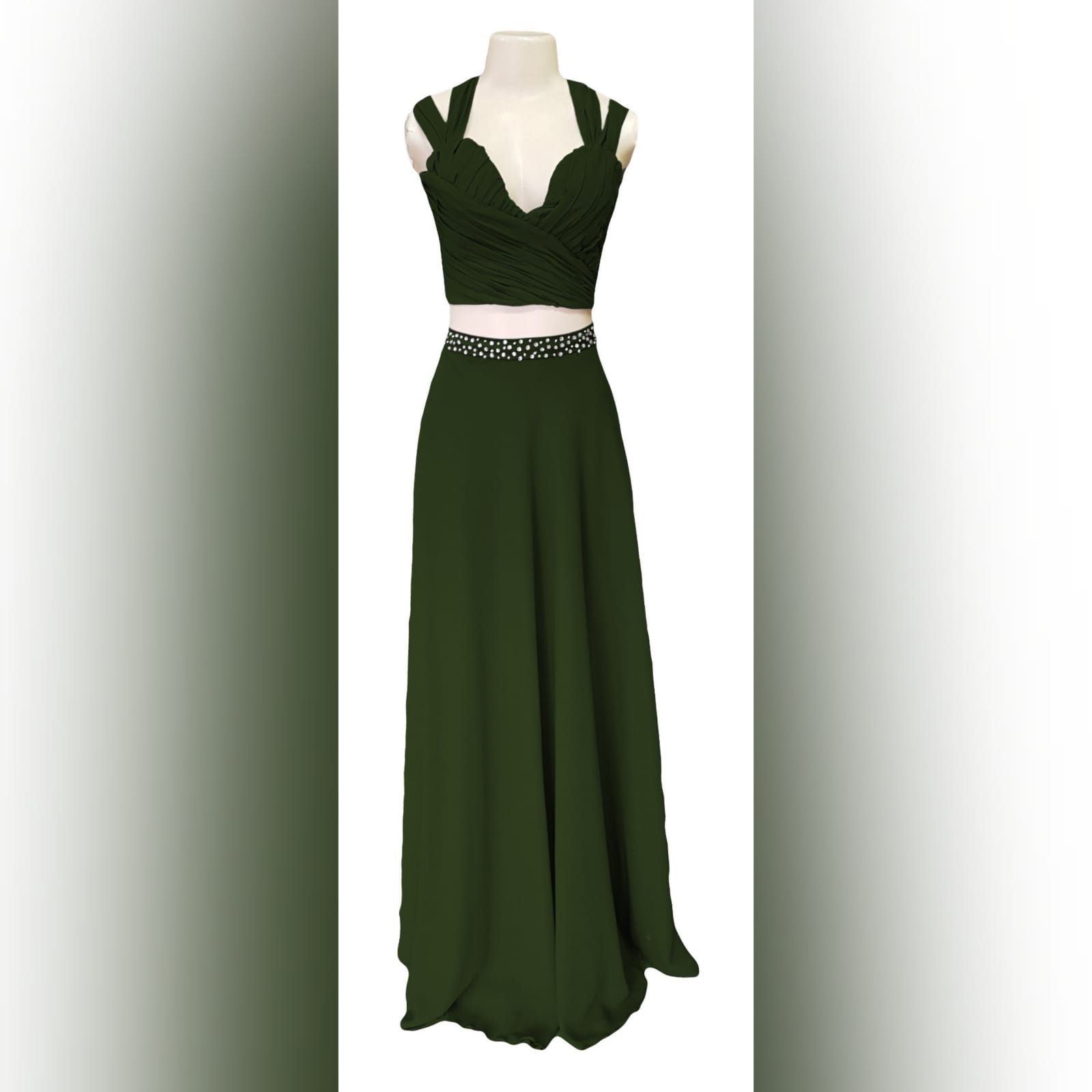 Olive green 2 piece prom dress 3 olive green 2 piece prom dress. Flowy long chiffon shirt with a little train and waistband detailed with silver beads. Pleated crop top with a rounded deep neckline , backless design with strap detail.