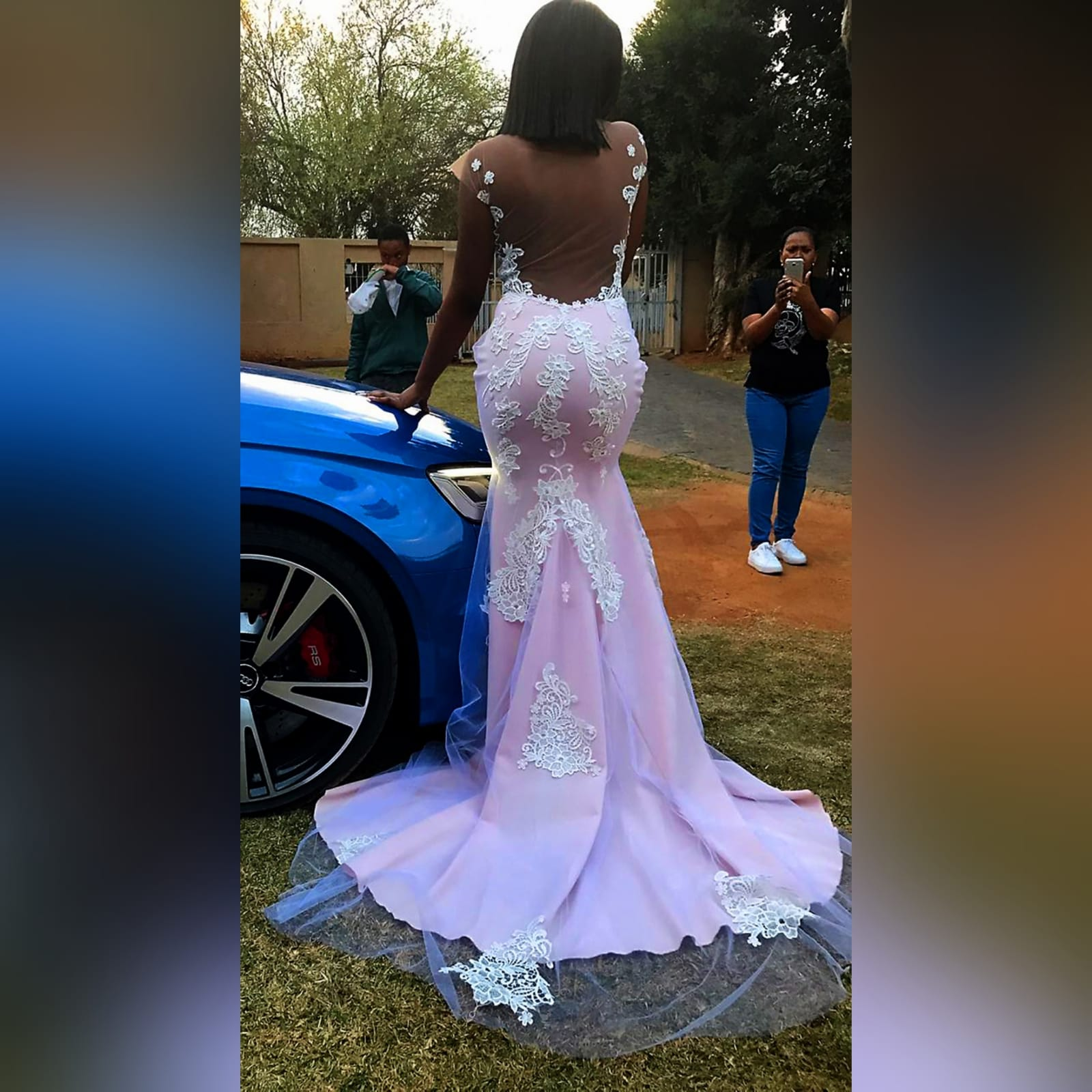 Pink and white lace soft mermaid prom dress 1 pink and white lace soft mermaid prom dress with an illusion bodice detailed with lace, an illusion open back. Bottom with an overlayer of tulle detailed with lace and a train.
