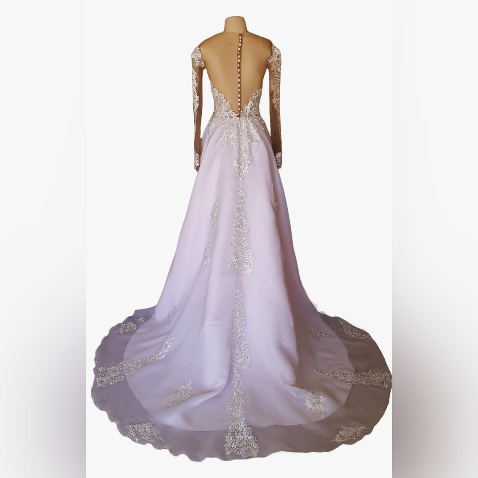 Pink and white organza lace prom dress 3 pink and white organza lace prom dress with an illusion off shoulder neckline, illusion lace long sleeves. An illusion backless design detailed with buttons. Lace on bodice and scattered throughout the dress with a train.