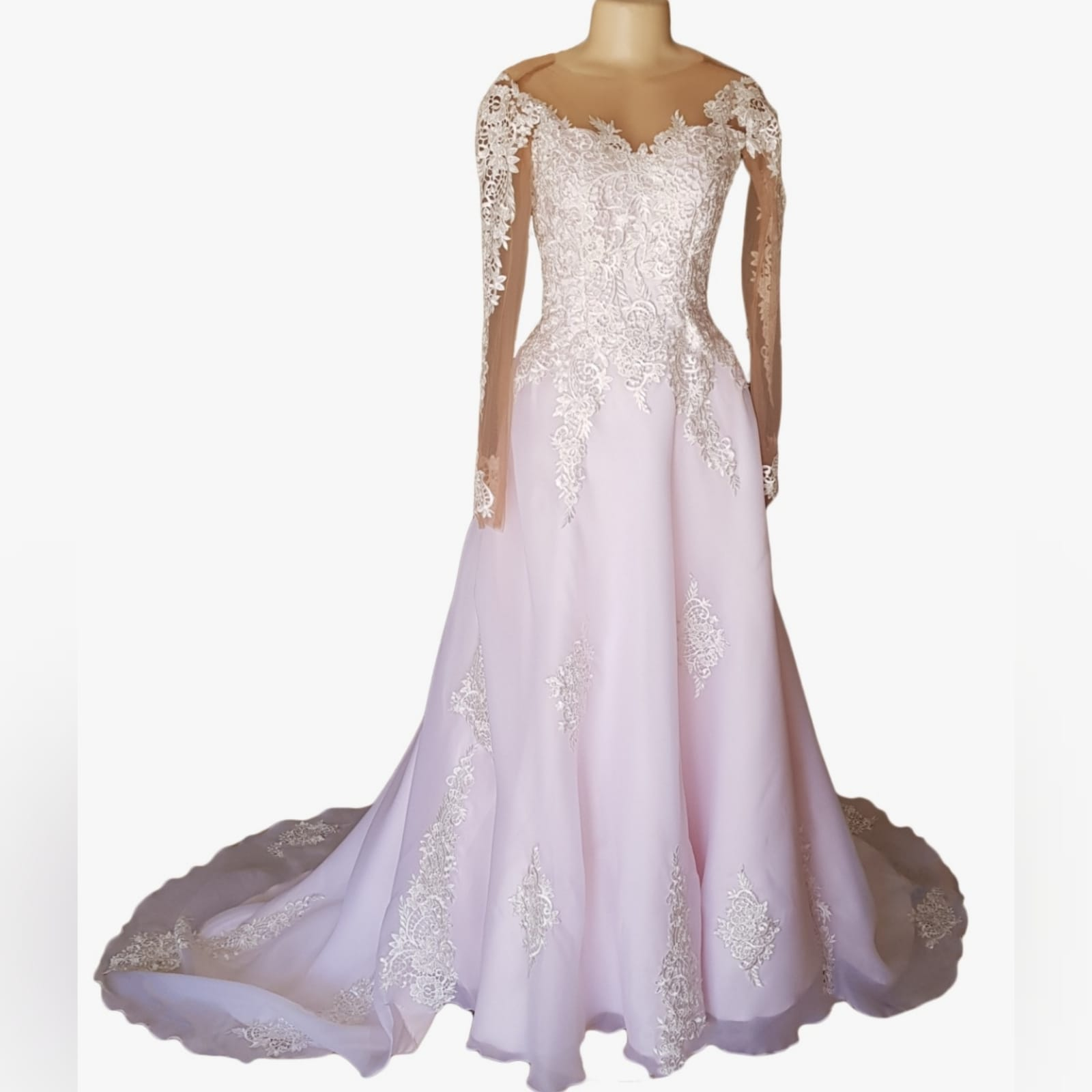Pink and white organza lace prom dress 7 pink and white organza lace prom dress with an illusion off shoulder neckline, illusion lace long sleeves. An illusion backless design detailed with buttons. Lace on bodice and scattered throughout the dress with a train.