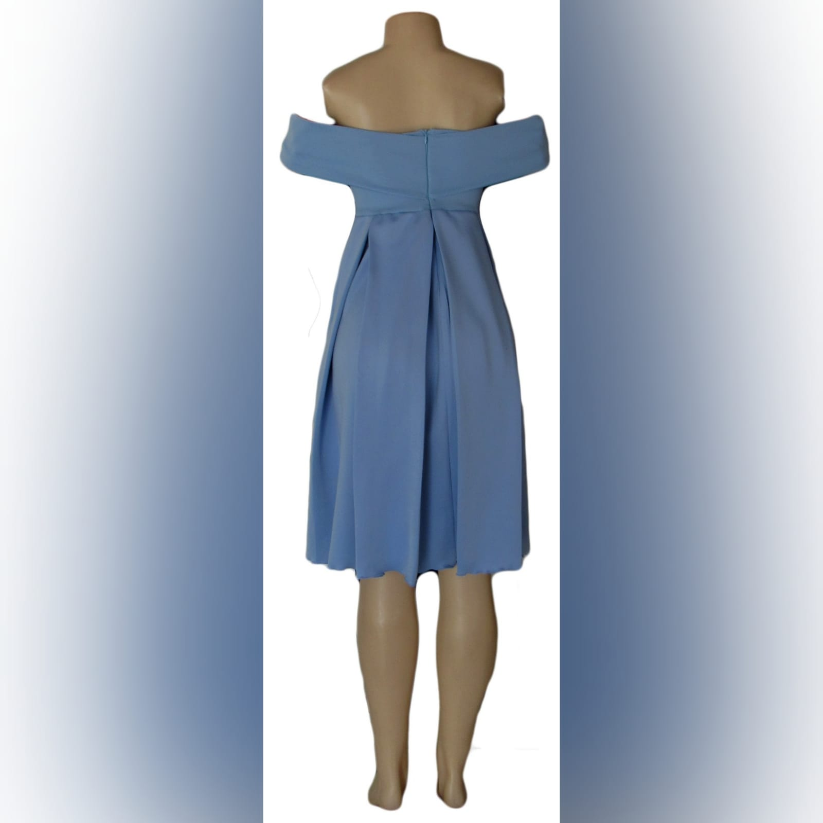 Short pale blue pleated cocktail dress 5 short pale blue pleated cocktail dress with a crossed bust design creating off shoulder short sleeves, pleated bottom with pockets.