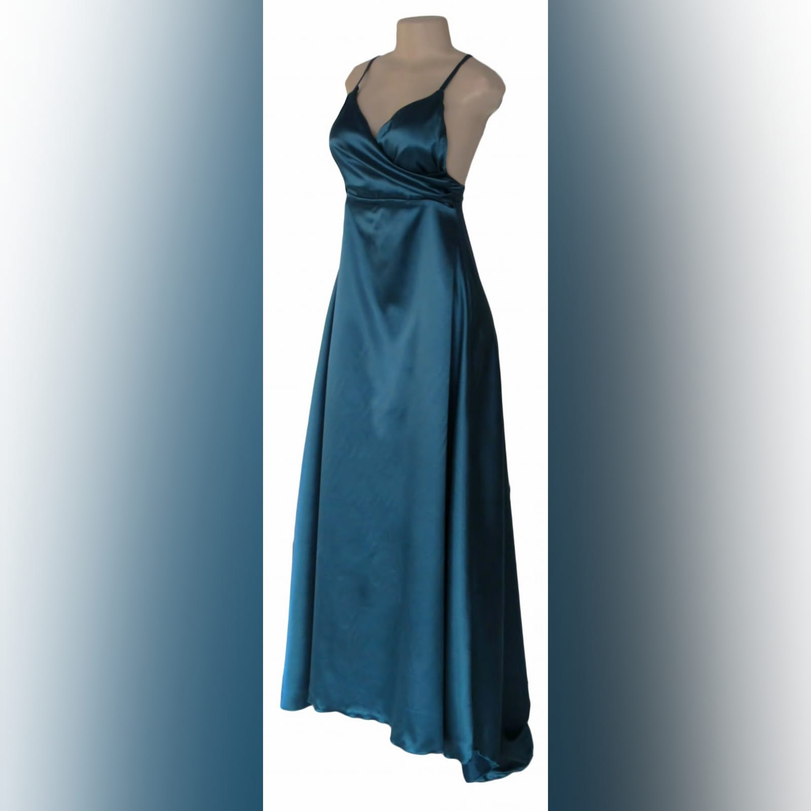 Teal long satin evening dress 1 teal long satin evening dress with a crossed bust neckline, backless design with 2 thin straps. With a small train.